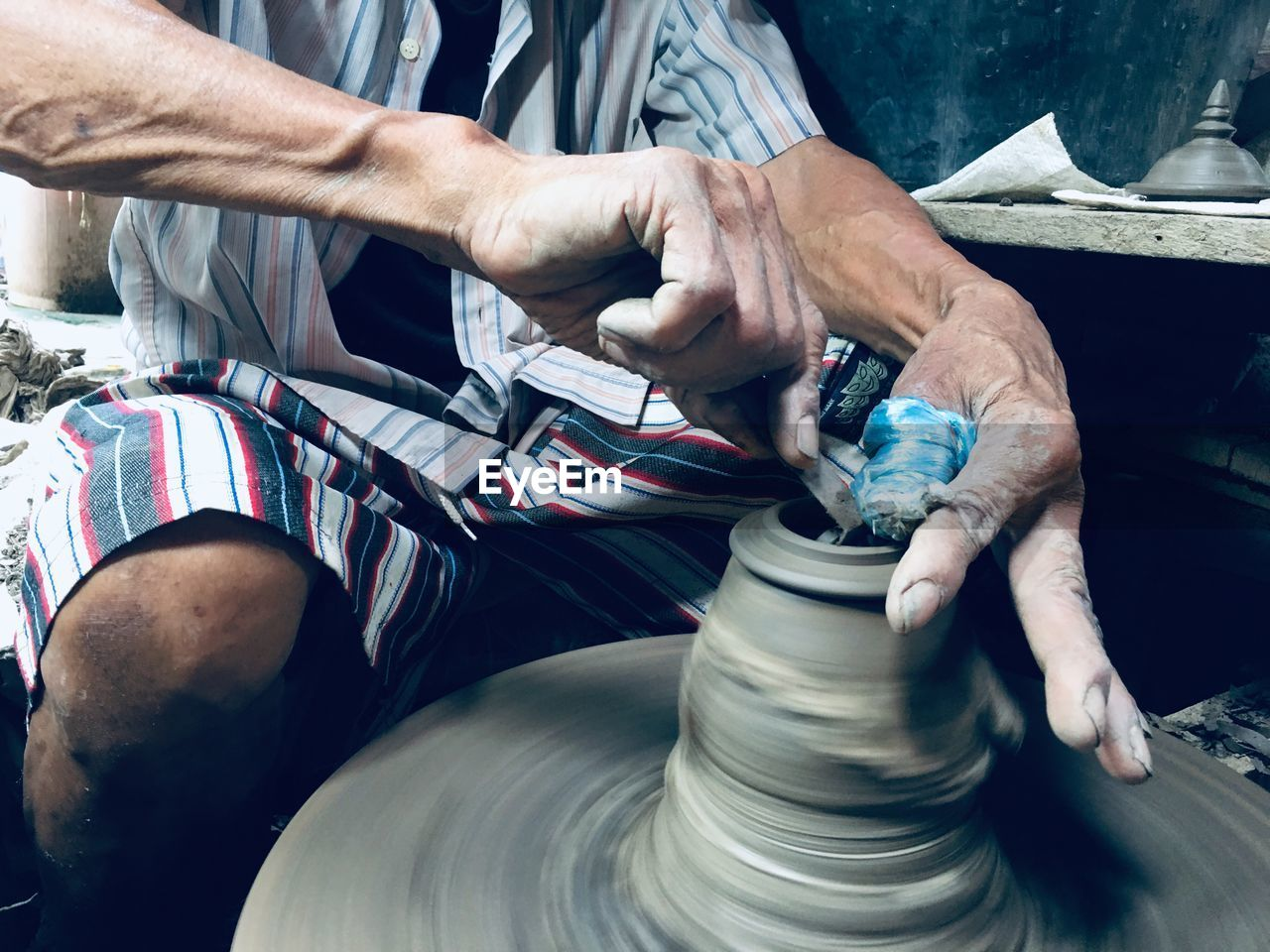 real people, working, art and craft, one person, skill, craft, workshop, human hand, occupation, hand, men, expertise, holding, human body part, creativity, indoors, making, craftsperson, motion