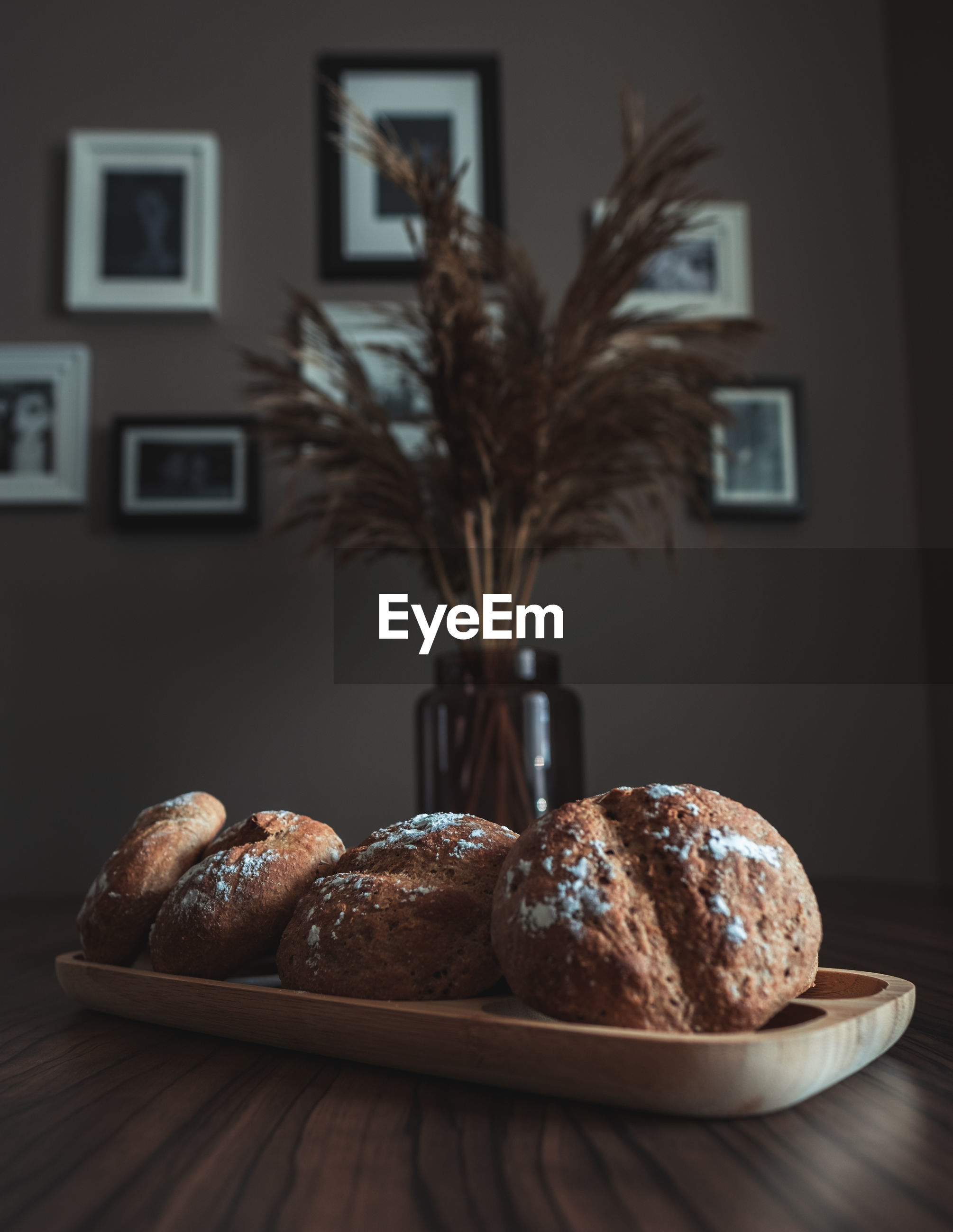 Close-up of fresh baked breads on table at home