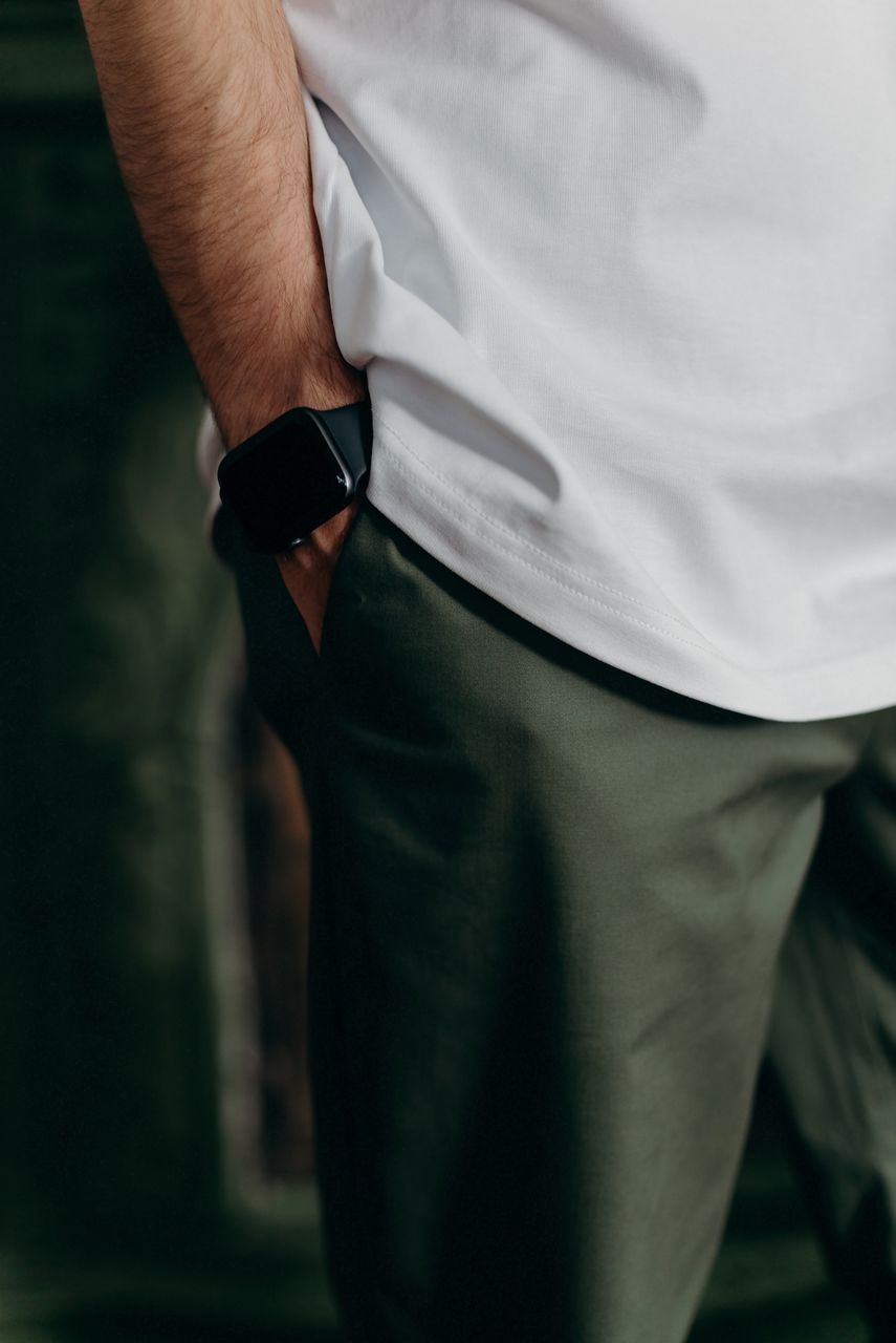 Midsection of man with hand in pocket