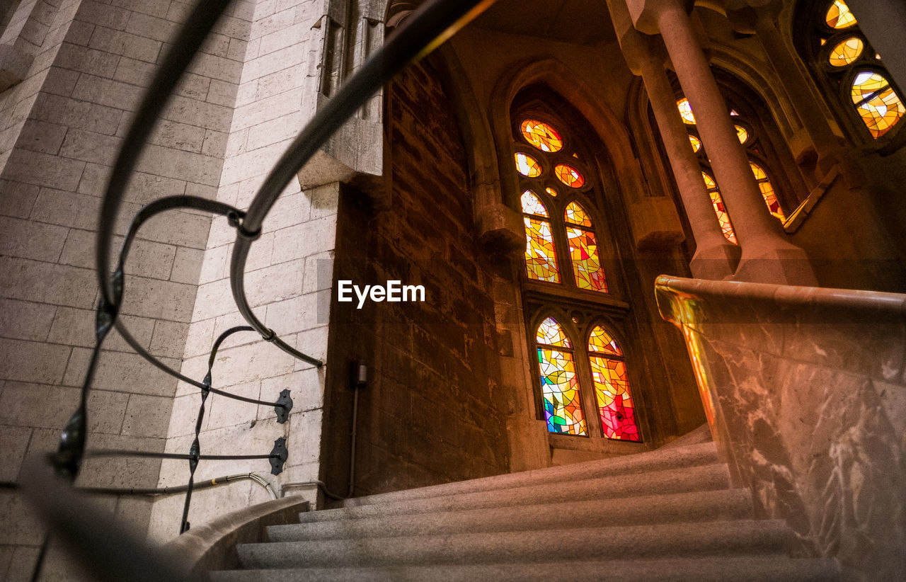 architecture, built structure, building, indoors, place of worship, religion, spirituality, belief, window, no people, day, low angle view, stained glass, wall - building feature, glass, sunlight, ceiling