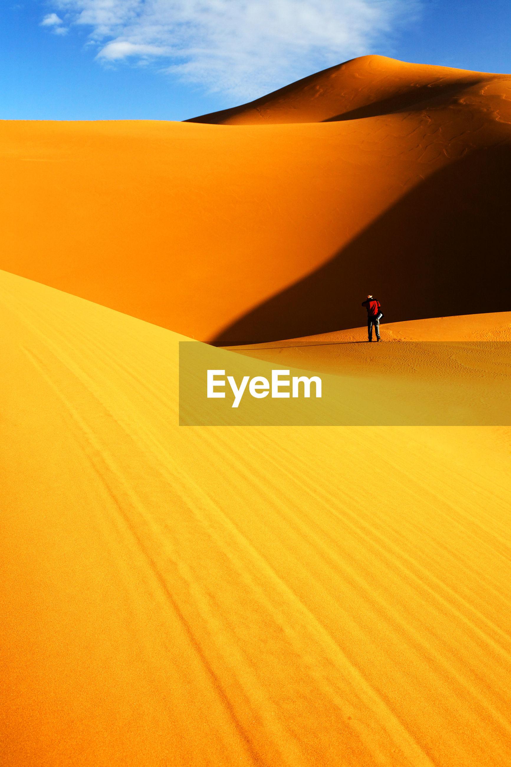 Sunlight falling on desert against sky