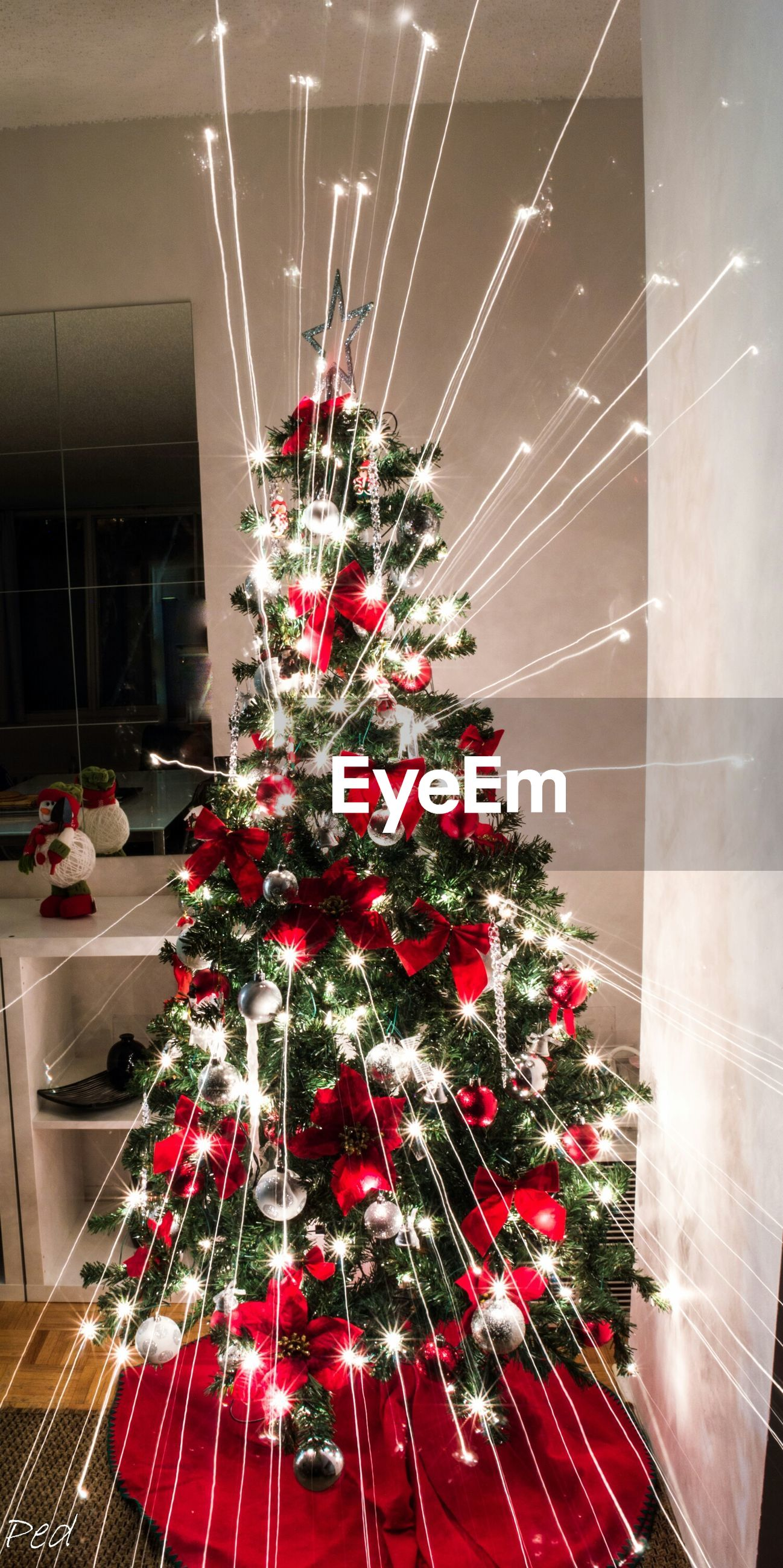 illuminated, hanging, low angle view, celebration, lighting equipment, night, indoors, decoration, red, arts culture and entertainment, built structure, electricity, architecture, ceiling, technology, no people, electric light, building exterior, event, christmas