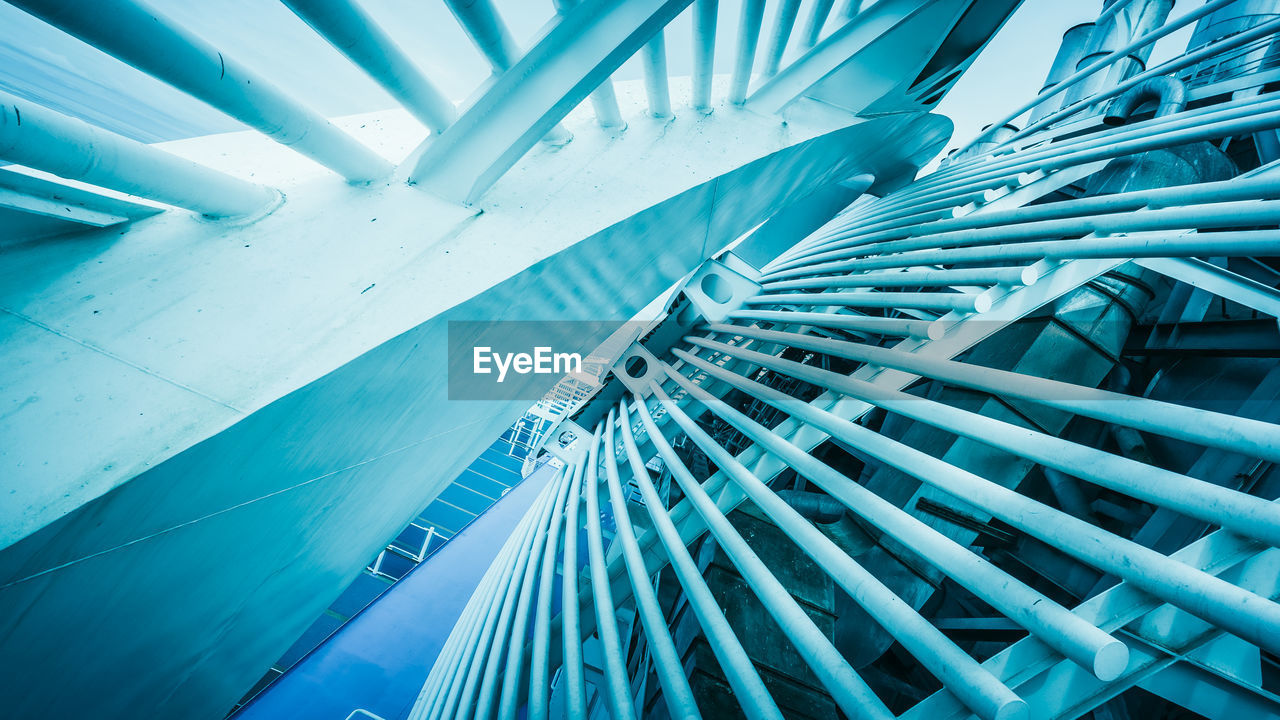 architecture, blue, built structure, no people, modern, low angle view, indoors, day, connection, pattern, sunlight, building, close-up, metal, city, technology, nature, railing, office building exterior, ceiling, turquoise colored