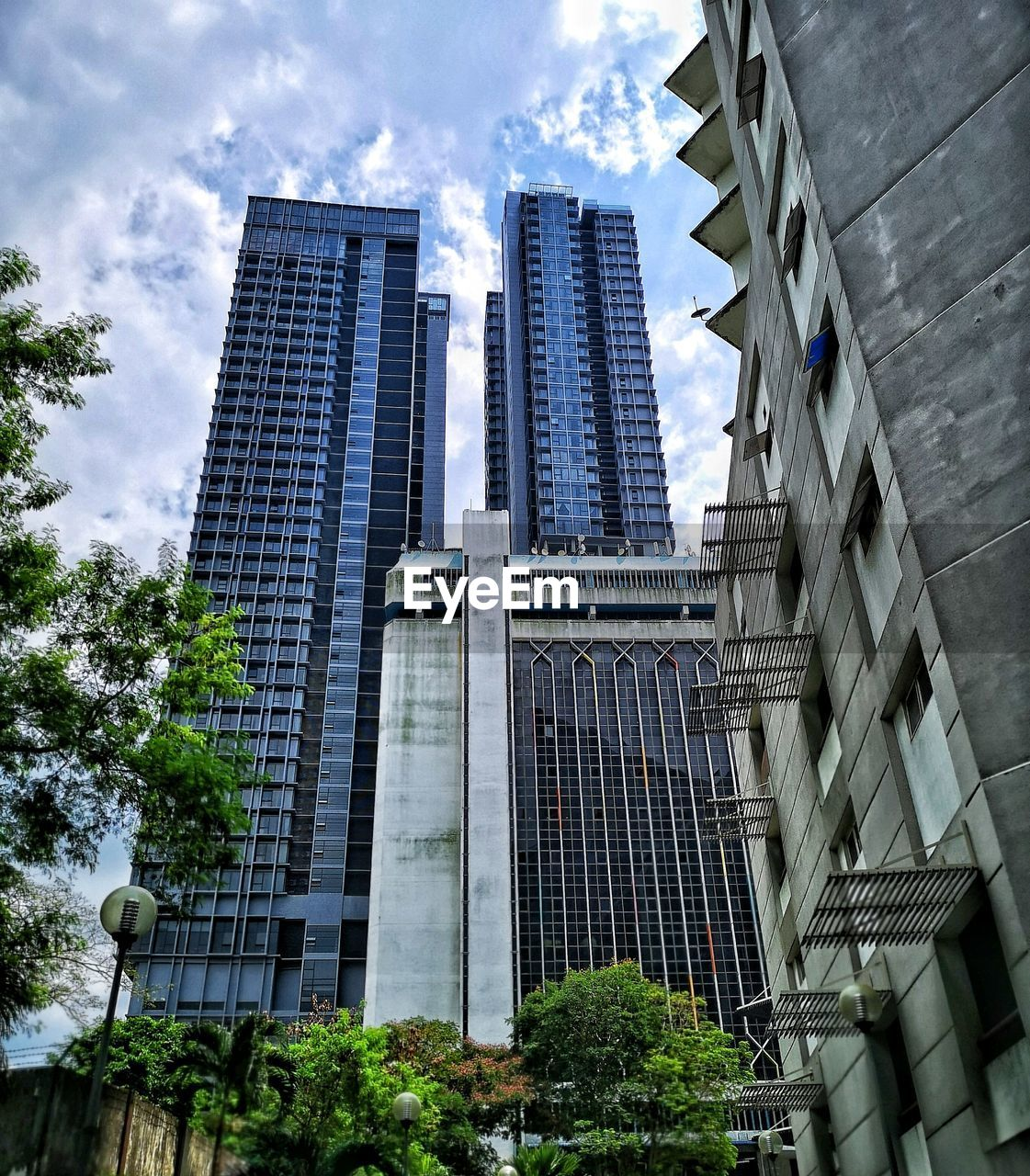 built structure, architecture, city, sky, building exterior, low angle view, building, cloud - sky, modern, office building exterior, tall - high, no people, office, nature, day, plant, tree, tower, skyscraper, outdoors, financial district, spire