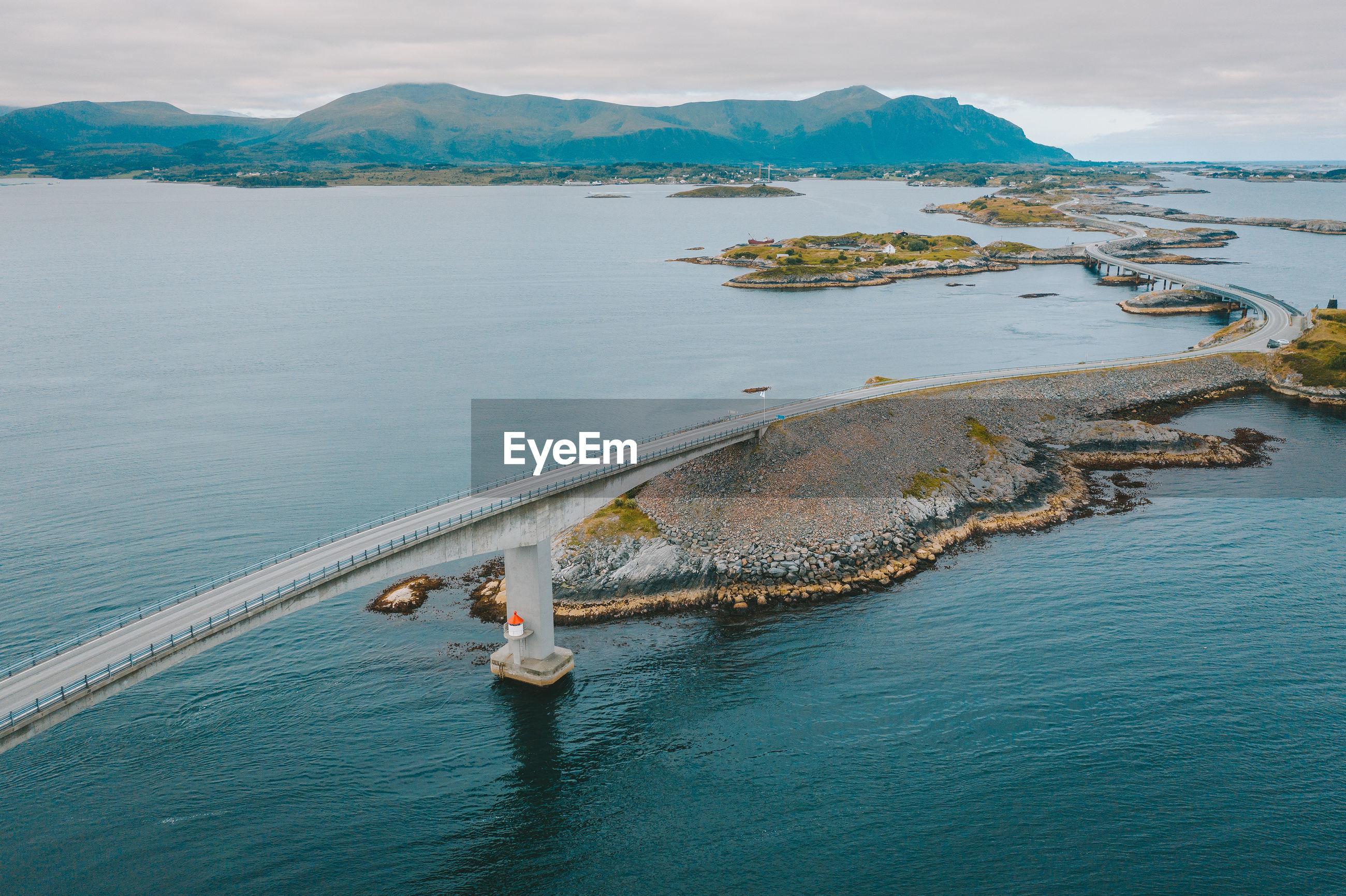 Aerial view of bridge by sea against sky