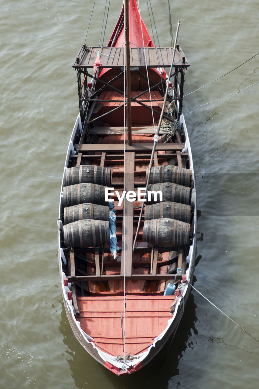 High Angle View Of Barrels In Boat On Lake