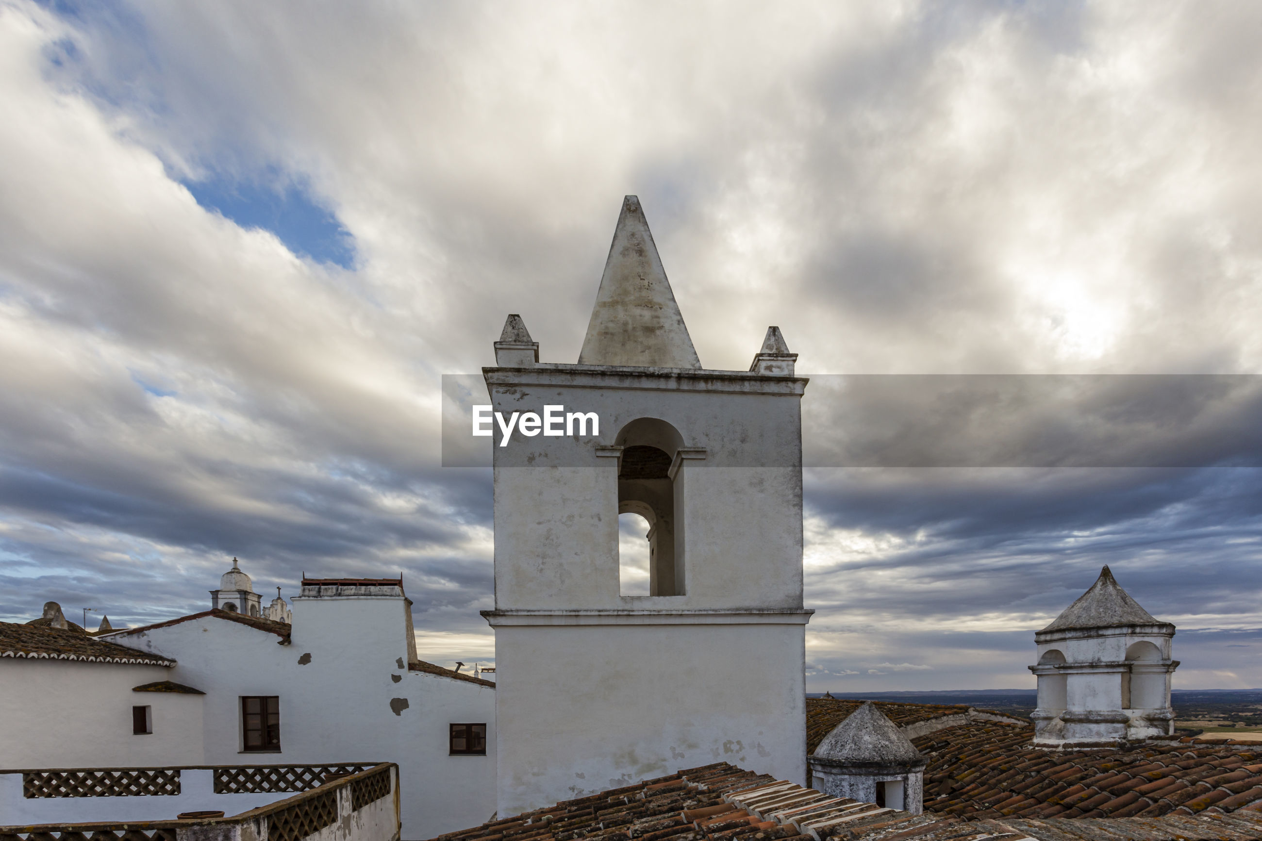 LOW ANGLE VIEW OF CHURCH AND BUILDINGS AGAINST SKY