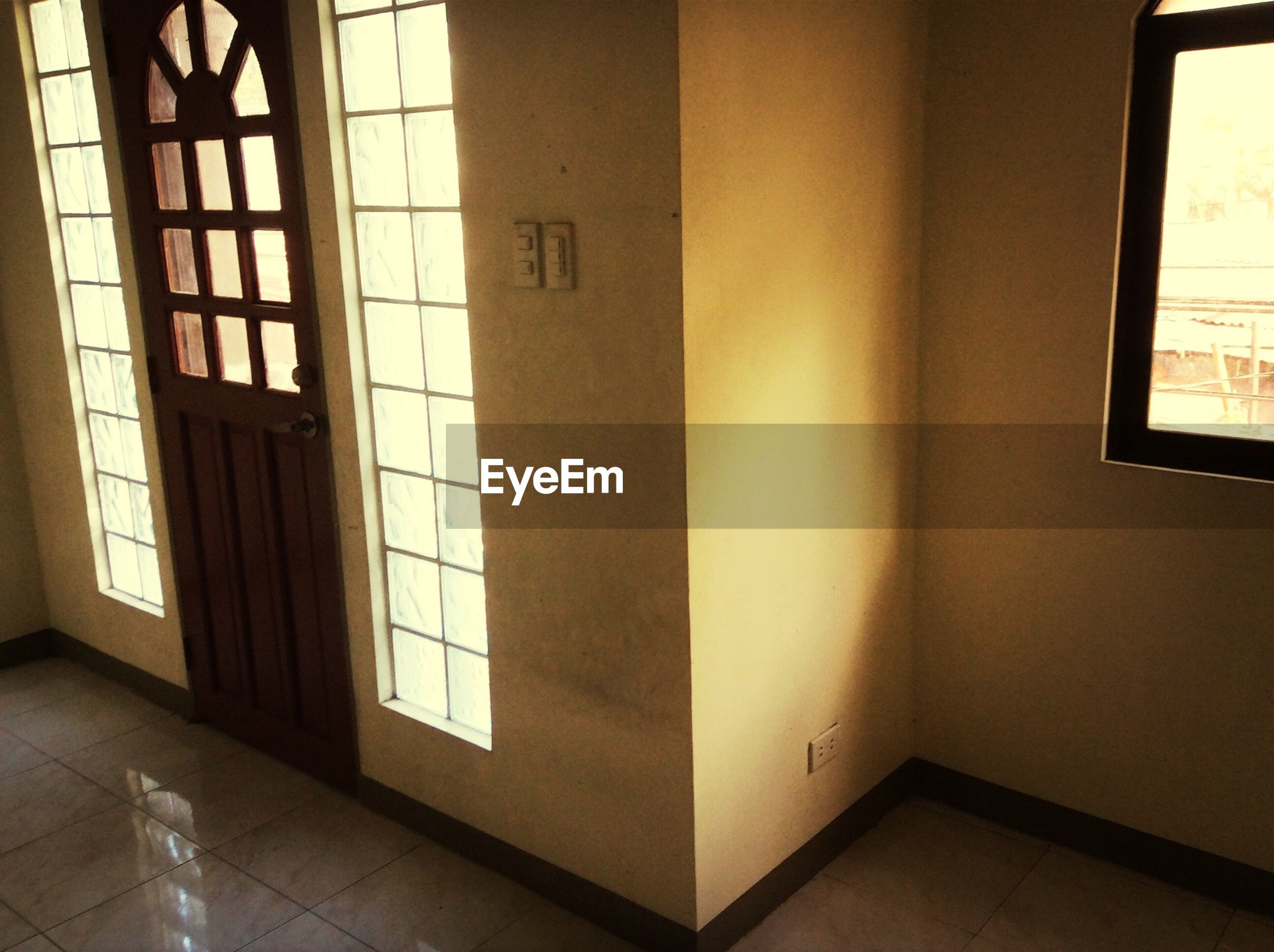 indoors, window, home interior, architecture, built structure, illuminated, glass - material, door, wall - building feature, domestic room, lighting equipment, house, wall, no people, transparent, absence, interior, room, flooring, table