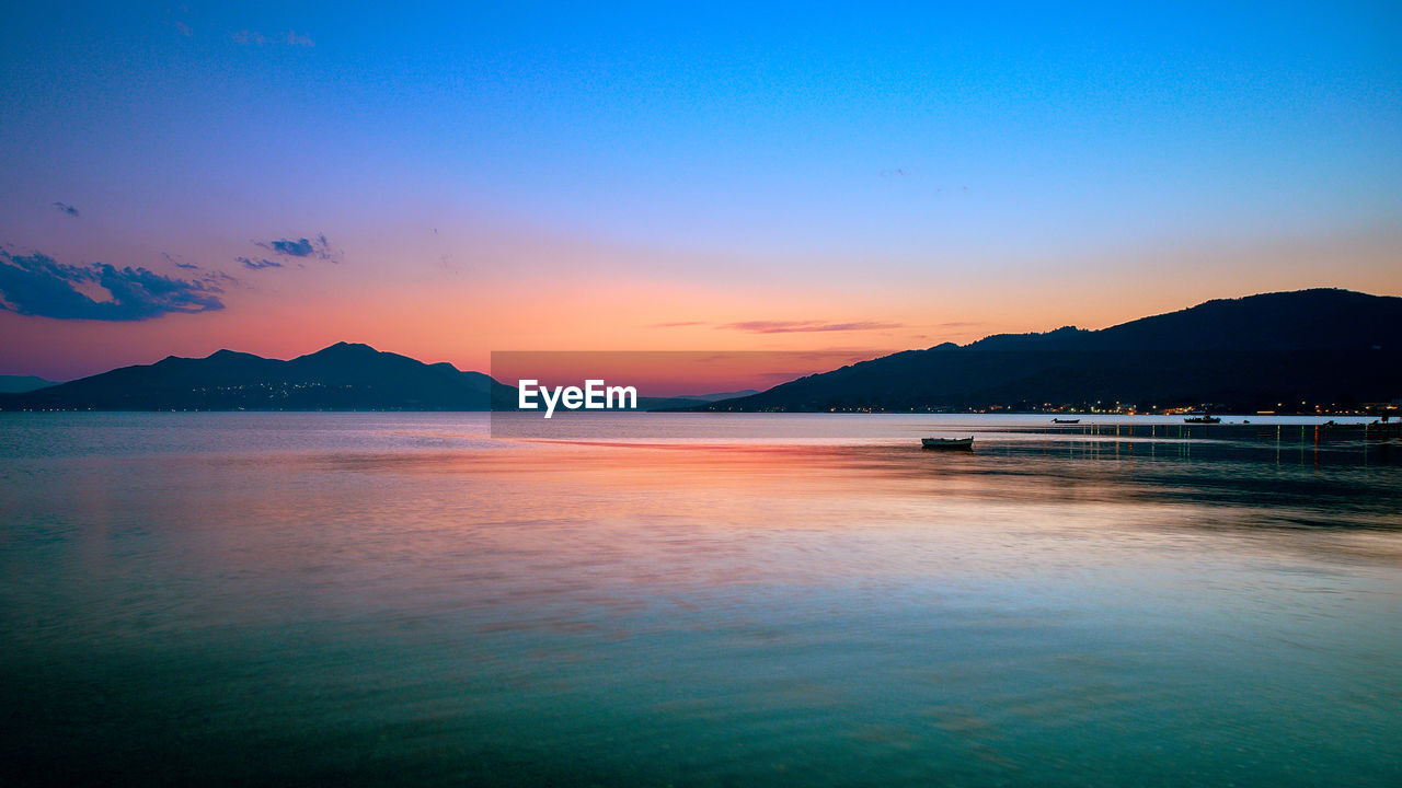 sky, water, sunset, scenics - nature, beauty in nature, tranquil scene, sea, tranquility, mountain, idyllic, beach, nature, land, no people, cloud - sky, orange color, waterfront, non-urban scene, outdoors