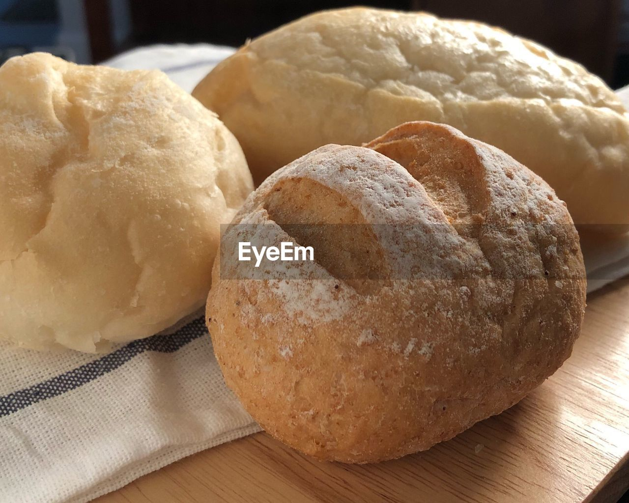 food and drink, food, freshness, still life, close-up, indoors, table, bread, no people, baked, focus on foreground, ready-to-eat, healthy eating, wellbeing, homemade, brown, cutting board, loaf of bread, high angle view, wood - material, temptation, dieting