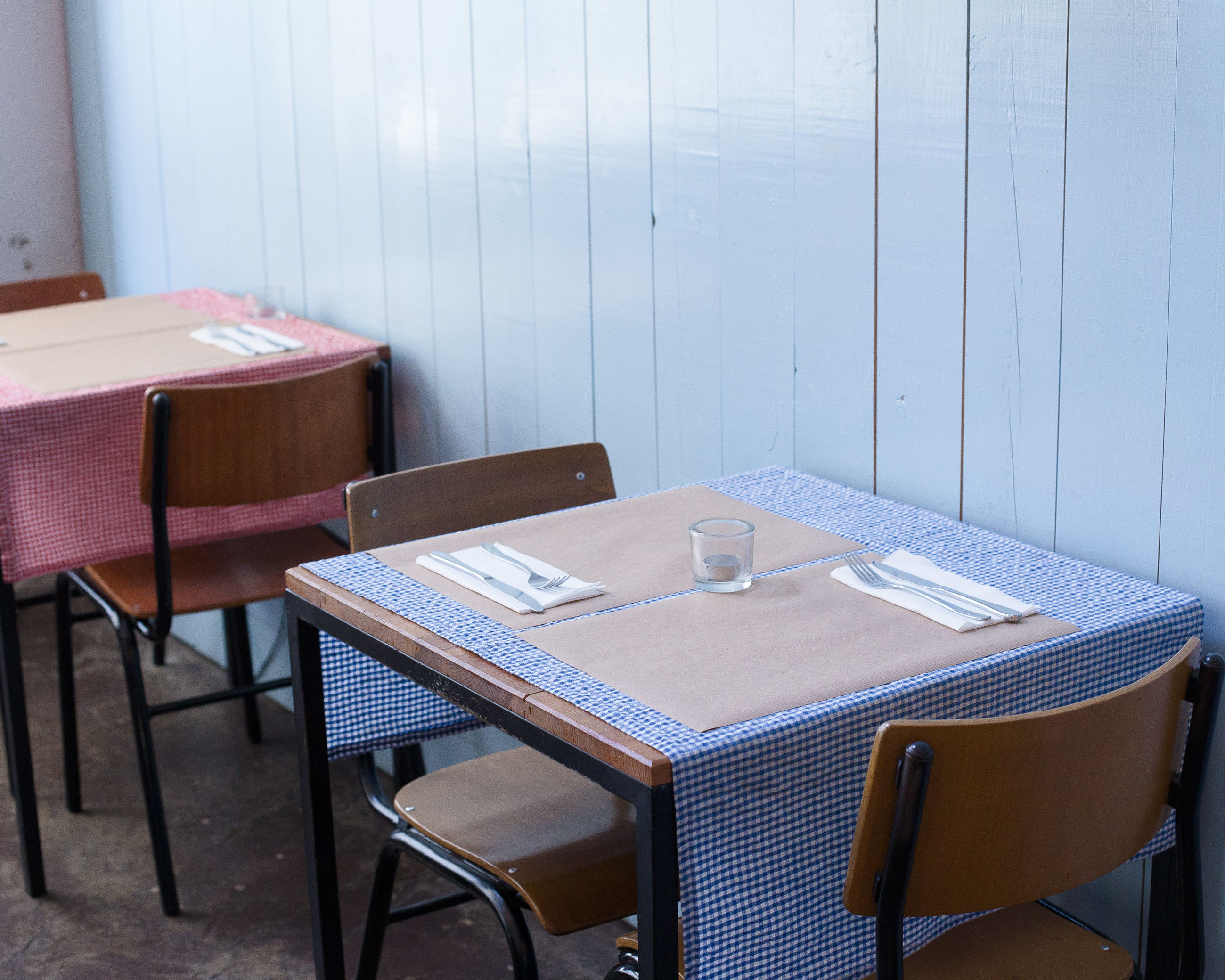 Tables and chairs arranged in cafe