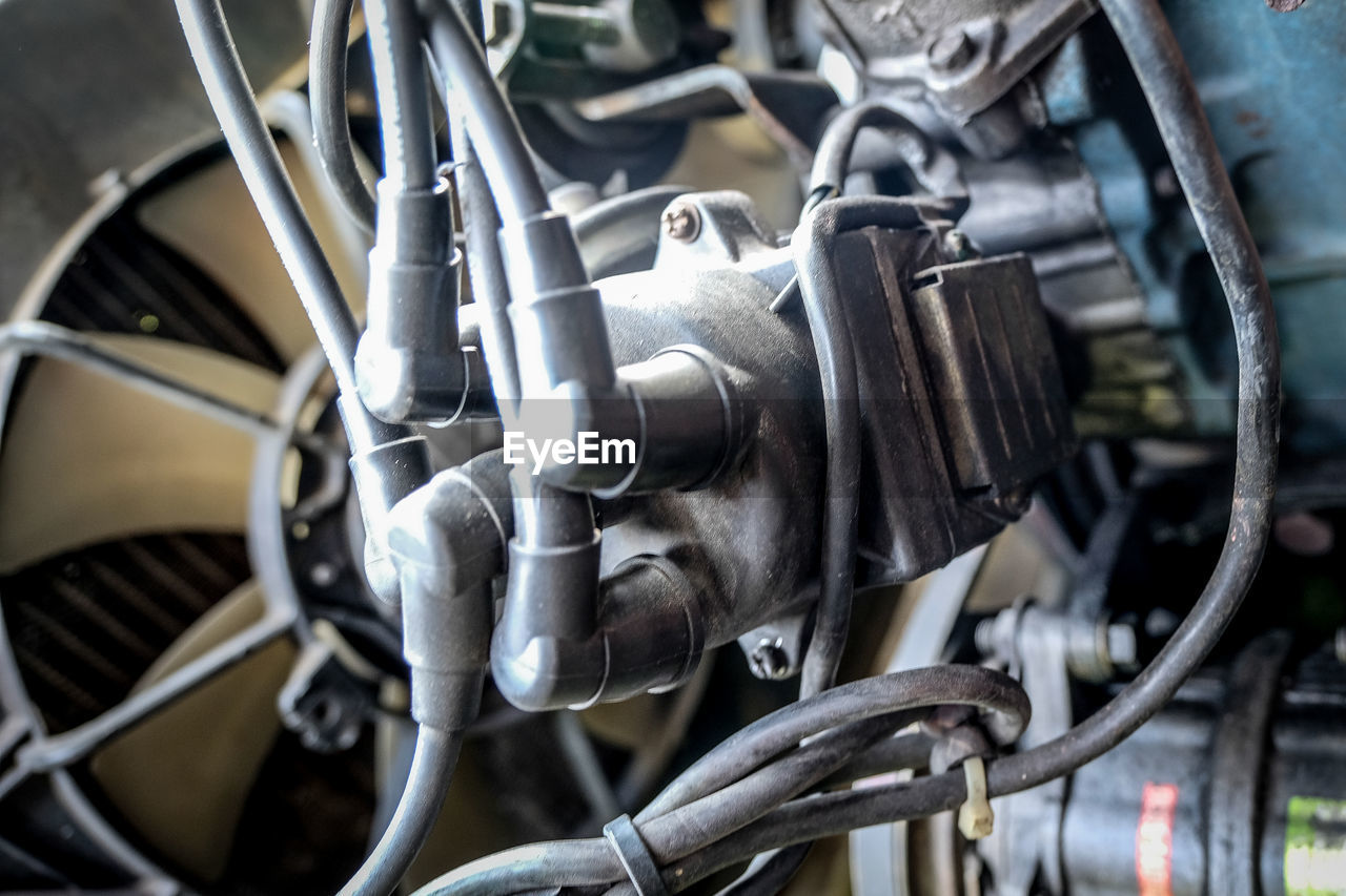 transportation, metal, engine, mode of transport, machine part, technology, machinery, industry, land vehicle, car, vehicle part, no people, wheel, jet engine, cable, complexity, close-up, mechanic, manufacturing equipment, day, outdoors, gear