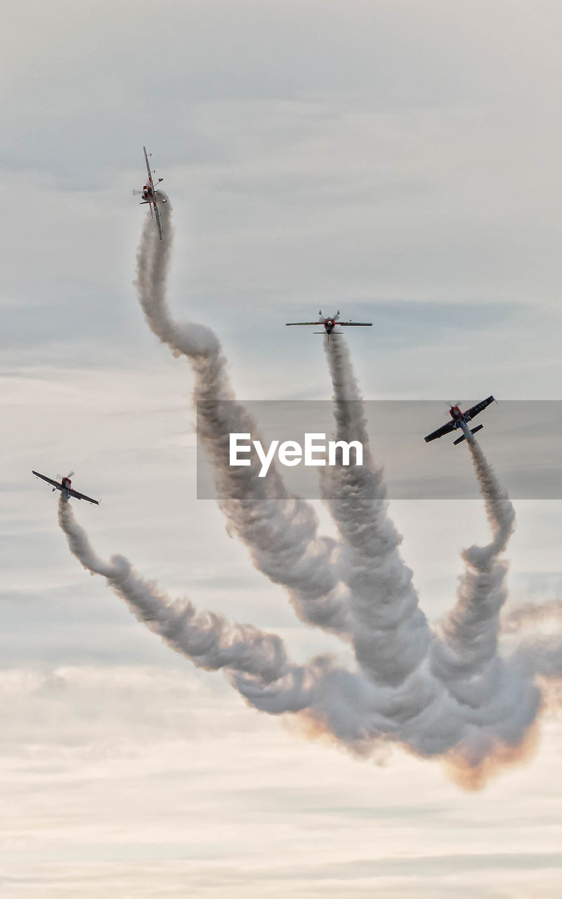 Airplane Flying Against Sky During Airshow