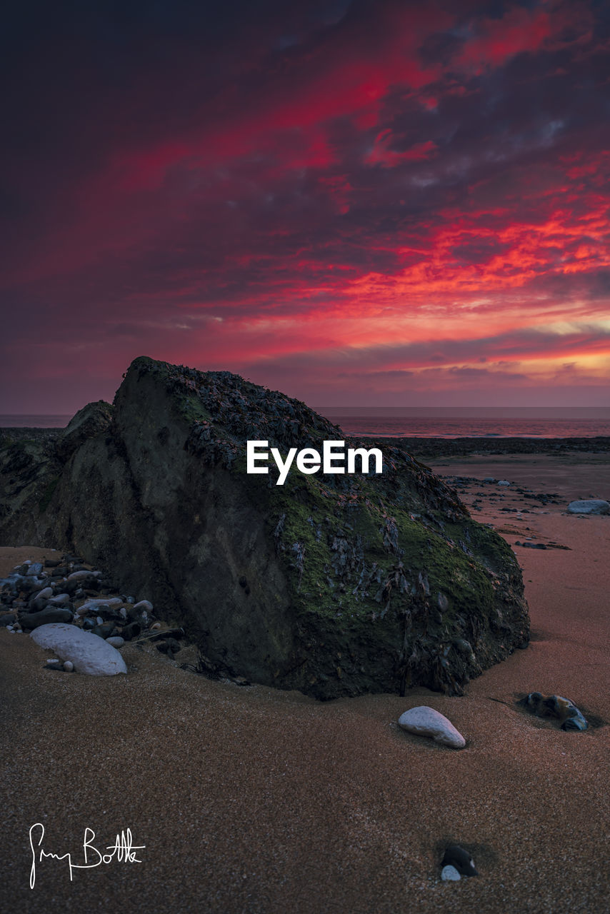 sunset, rock - object, beauty in nature, nature, tranquility, sky, scenics, landscape, outdoors, tranquil scene, beach, no people, adventure, day