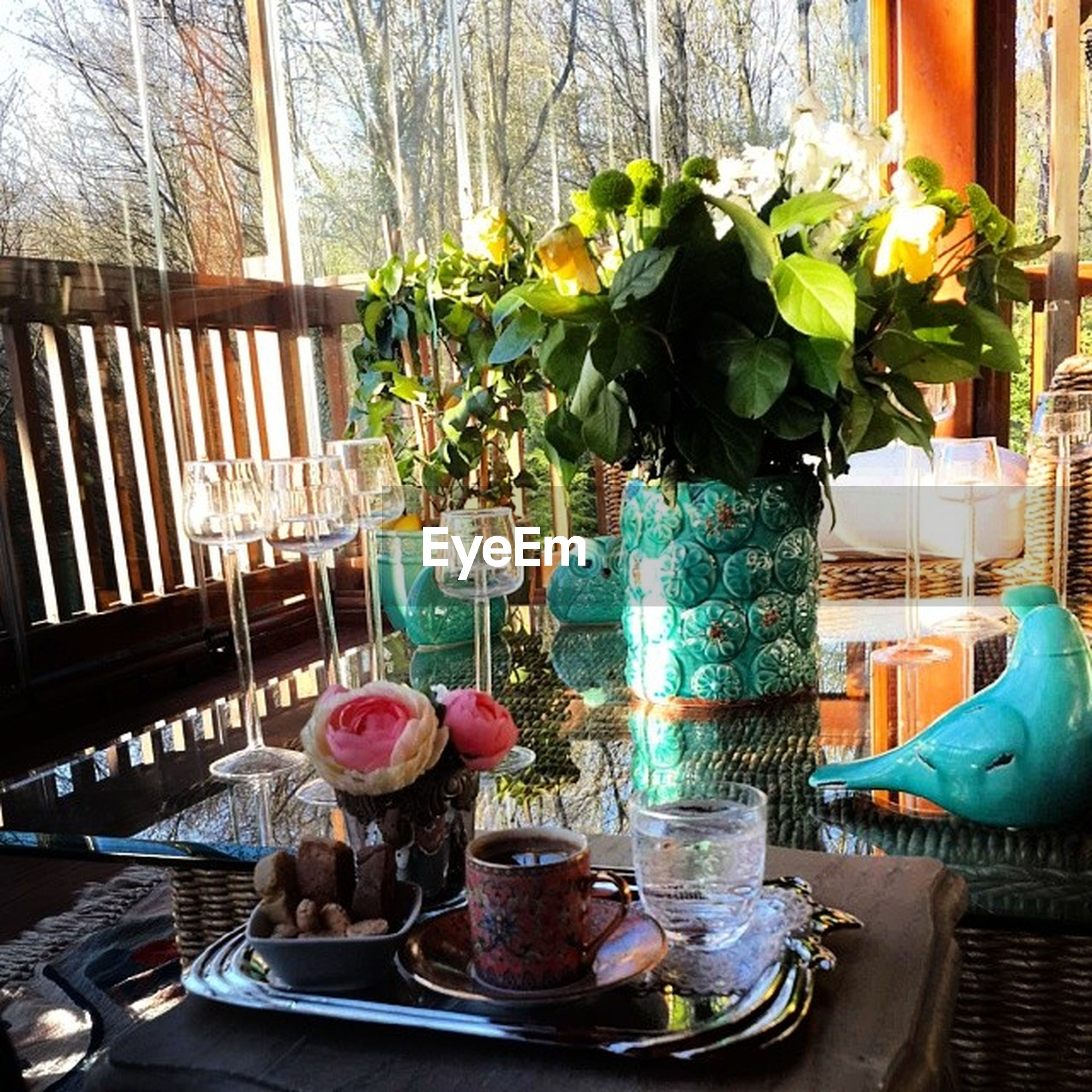 flower, vase, table, indoors, potted plant, freshness, flower pot, decoration, fragility, plant, flower arrangement, chair, glass - material, growth, home interior, window, bouquet, petal, still life, wood - material