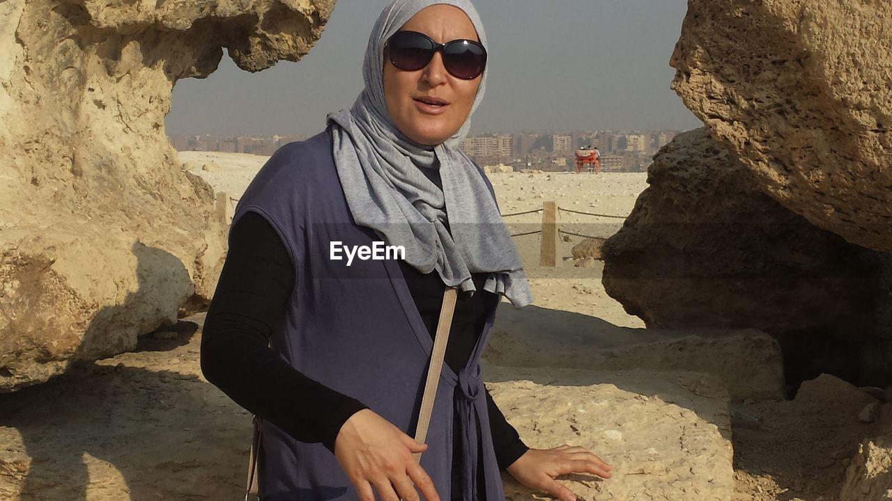 Portrait Of Woman Standing Against Rock