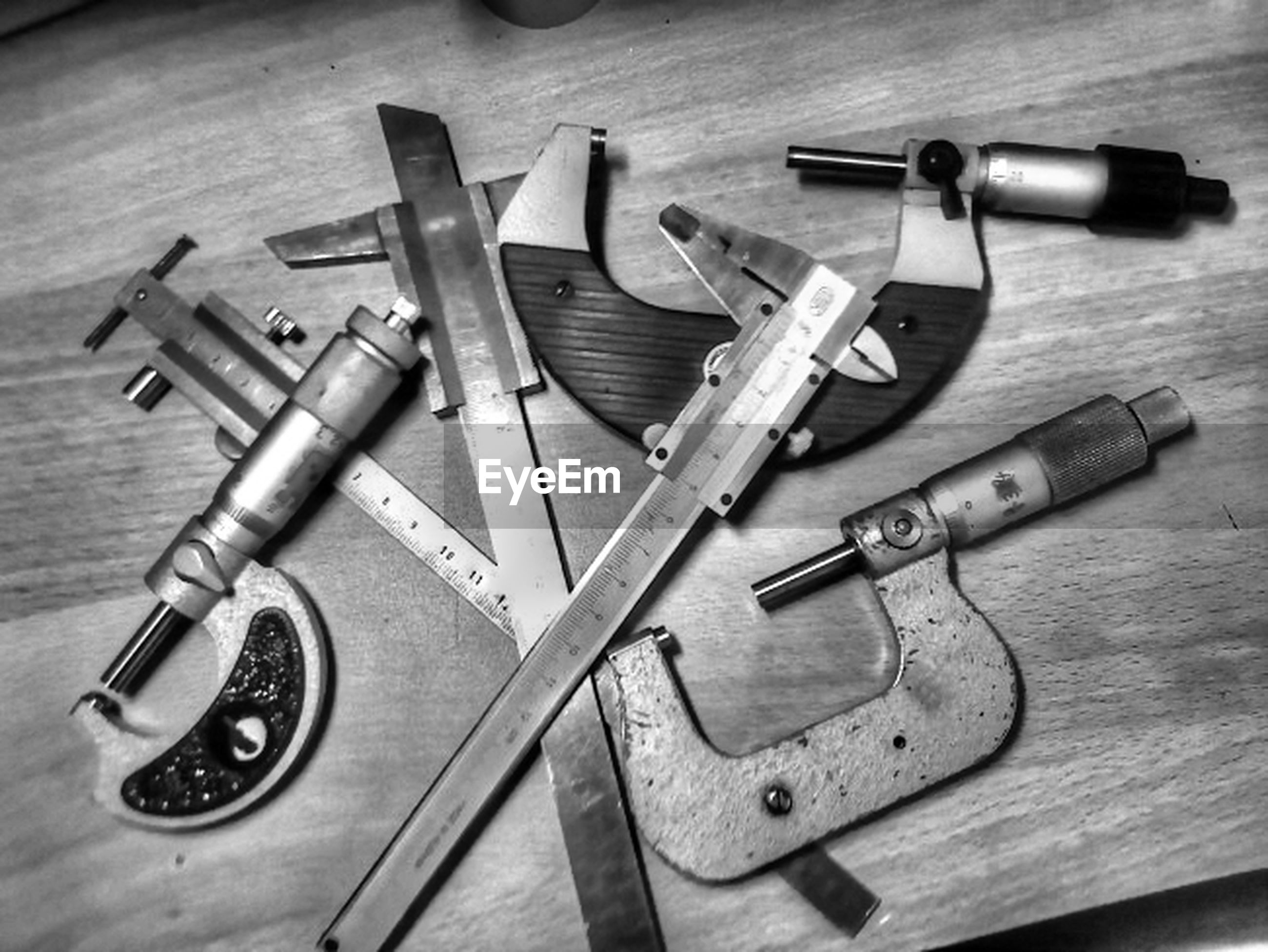 indoors, still life, table, wood - material, close-up, high angle view, work tool, equipment, wooden, metal, variation, large group of objects, pencil, no people, music, old-fashioned, key, selective focus, technology, wood
