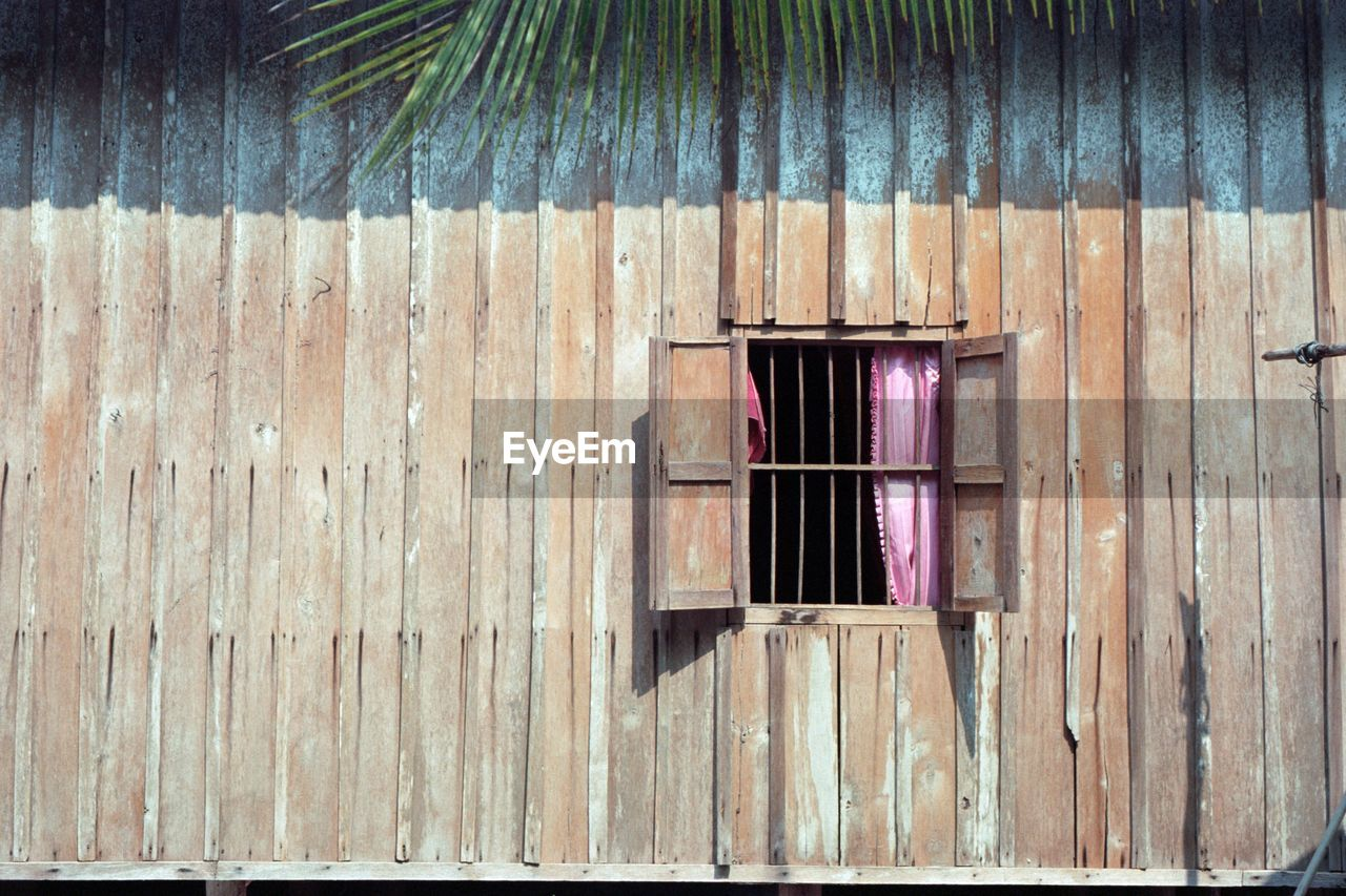 wood - material, architecture, window, day, built structure, no people, building exterior, pattern, house, building, wood, outdoors, wall, old, wall - building feature, entrance, close-up, door, corrugated iron, residential district, iron, corrugated