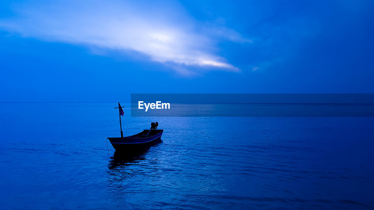 nautical vessel, sky, water, transportation, mode of transportation, sea, horizon over water, waterfront, beauty in nature, horizon, scenics - nature, cloud - sky, blue, tranquility, one person, tranquil scene, nature, idyllic, non-urban scene, outdoors
