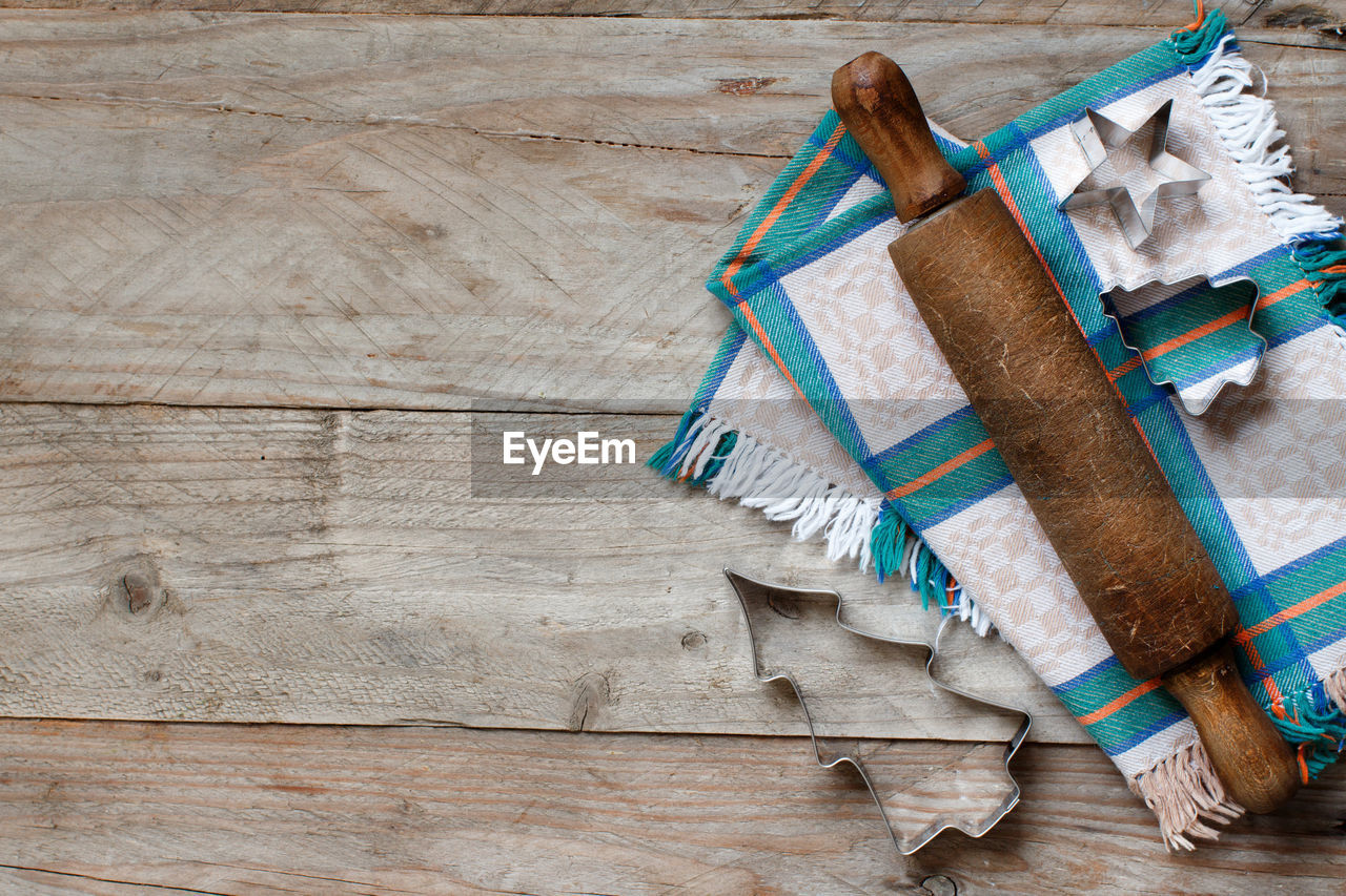 wood - material, no people, indoors, high angle view, table, old, brown, group of objects, close-up, directly above, animal, flooring, mammal, still life, backgrounds, relaxation, copy space, animal themes, large group of objects
