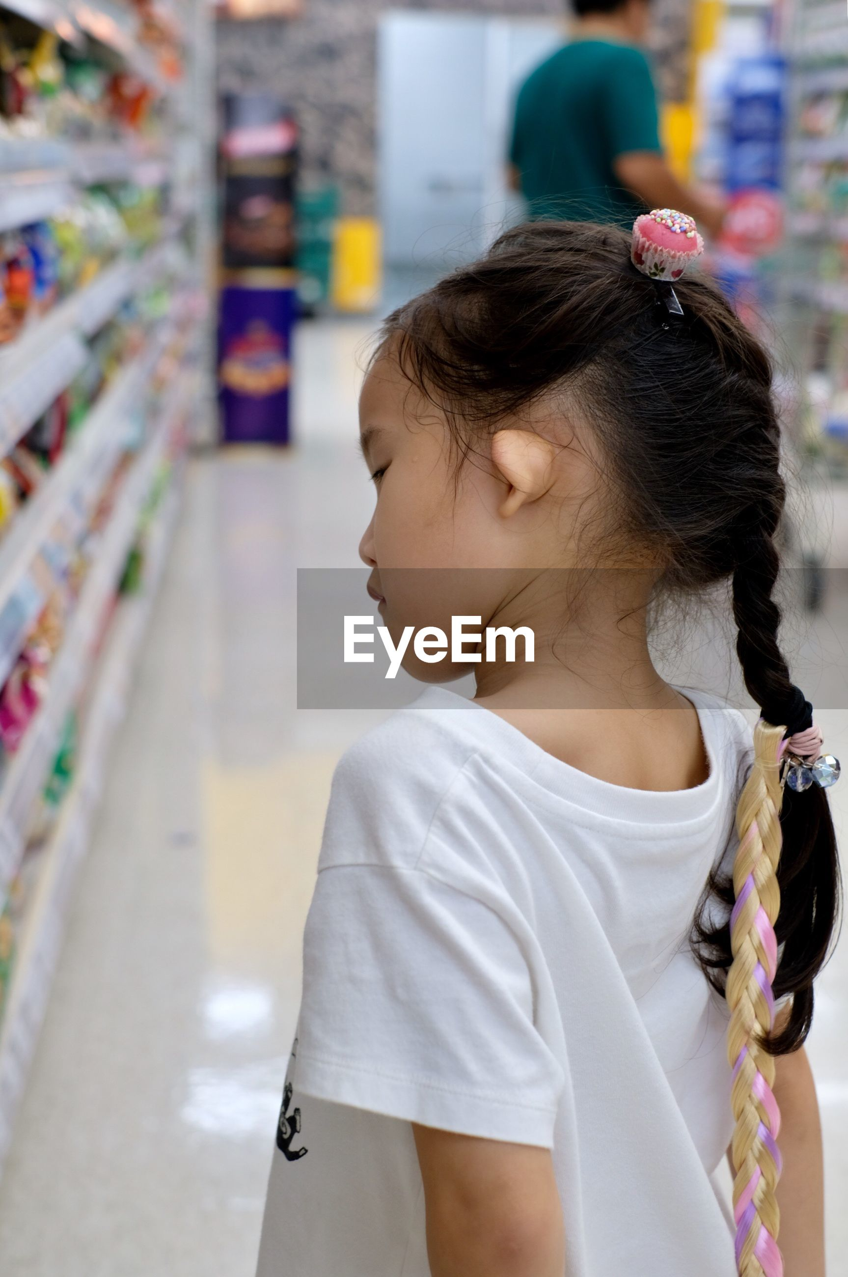 Side view of girl in supermarket