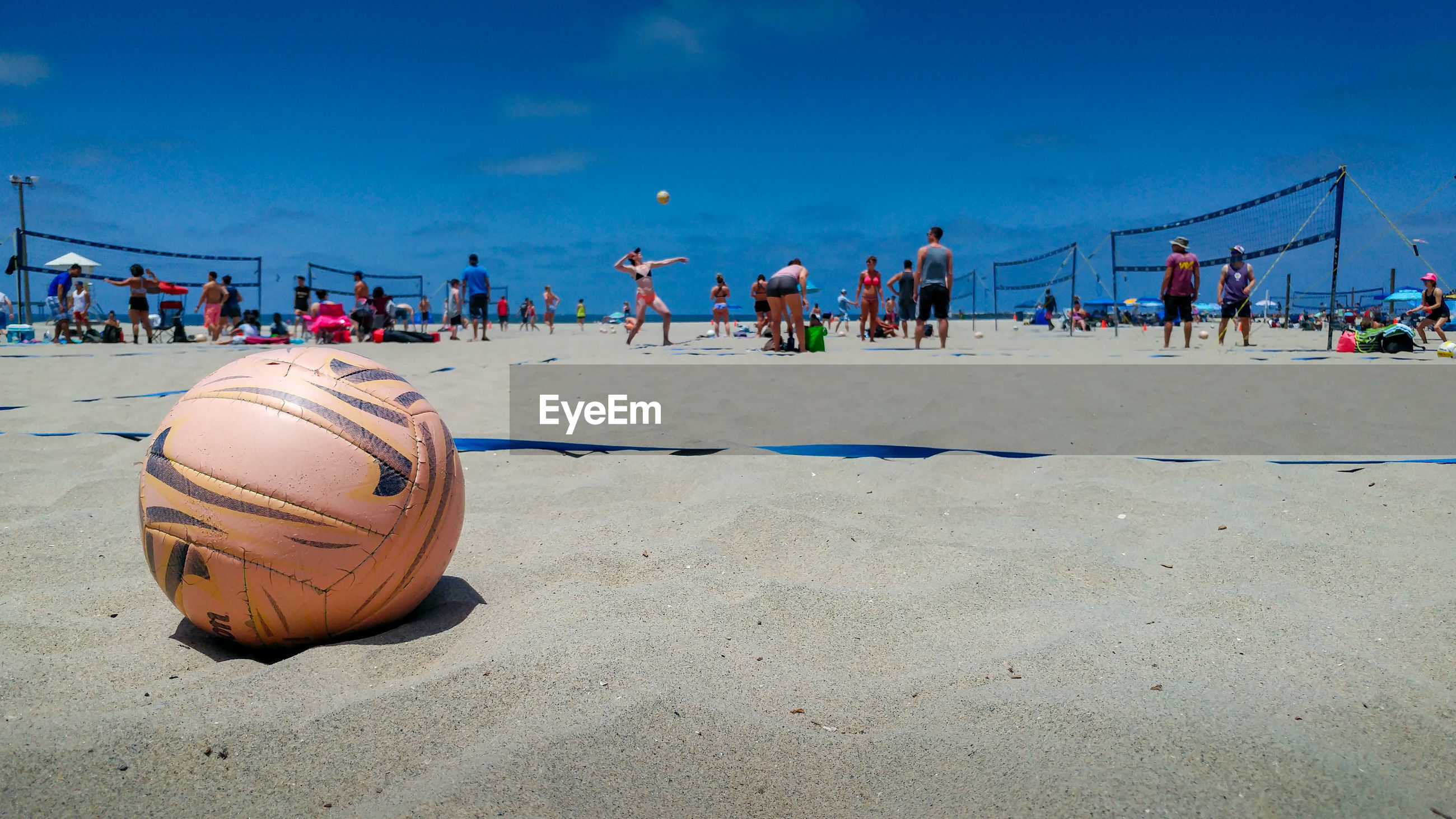 Close-up of volleyball people on at beach against sky