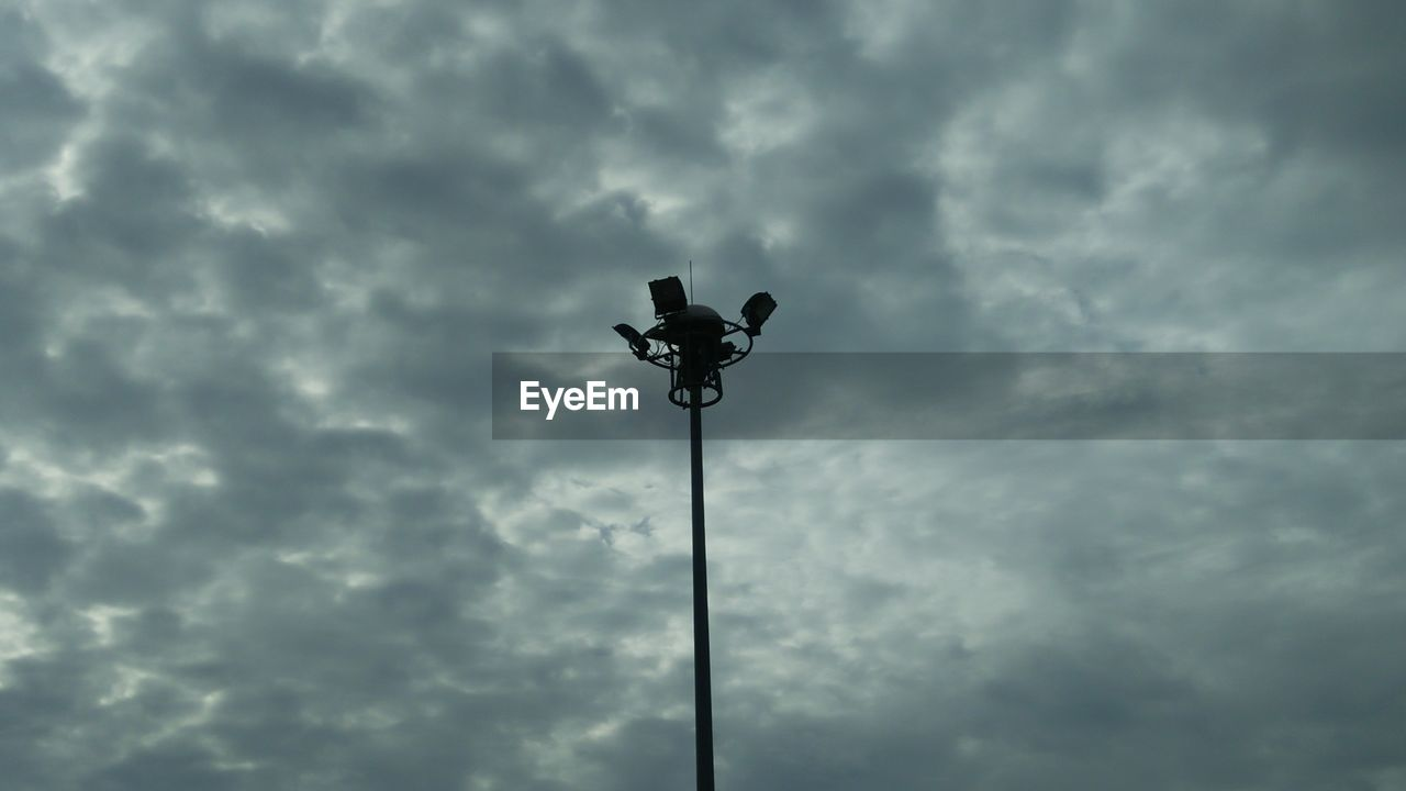 cloud - sky, sky, low angle view, street, lighting equipment, street light, nature, no people, electricity, day, outdoors, overcast, technology, light, floodlight, pole, storm, dusk, electric light, electric lamp, power supply