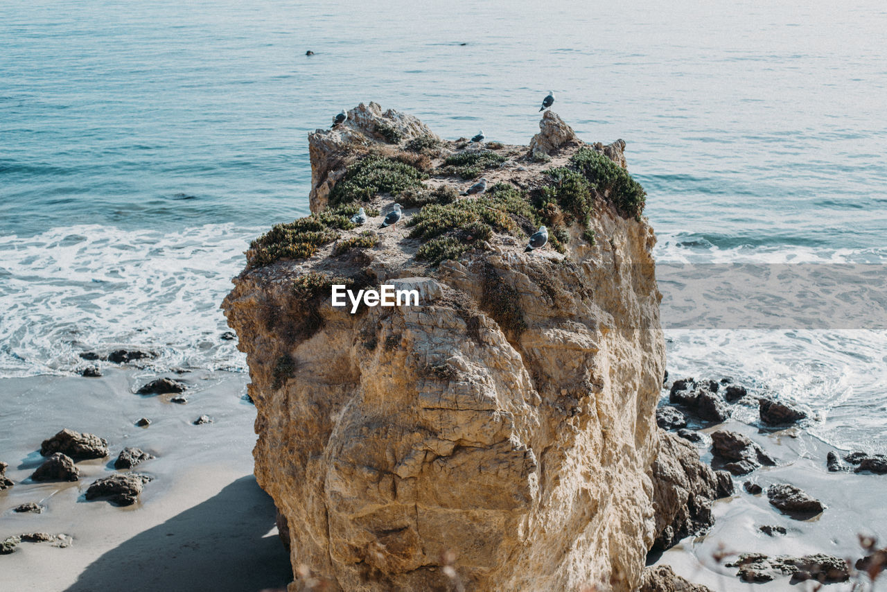 Aerial view of rock formation at sea