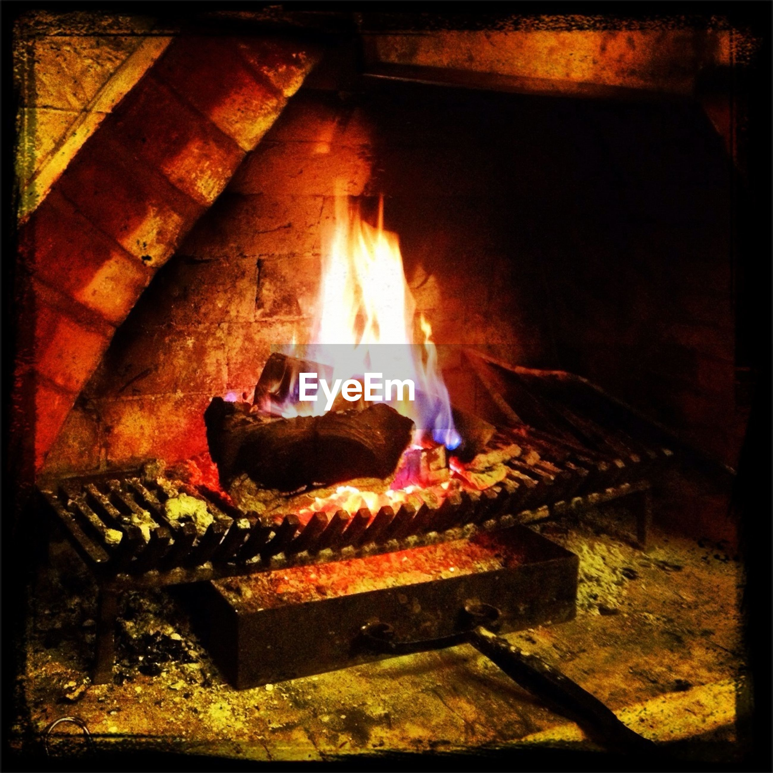 flame, fire - natural phenomenon, burning, heat - temperature, transfer print, auto post production filter, firewood, indoors, glowing, fire, bonfire, night, fireplace, high angle view, heat, wood - material, illuminated, steps, orange color