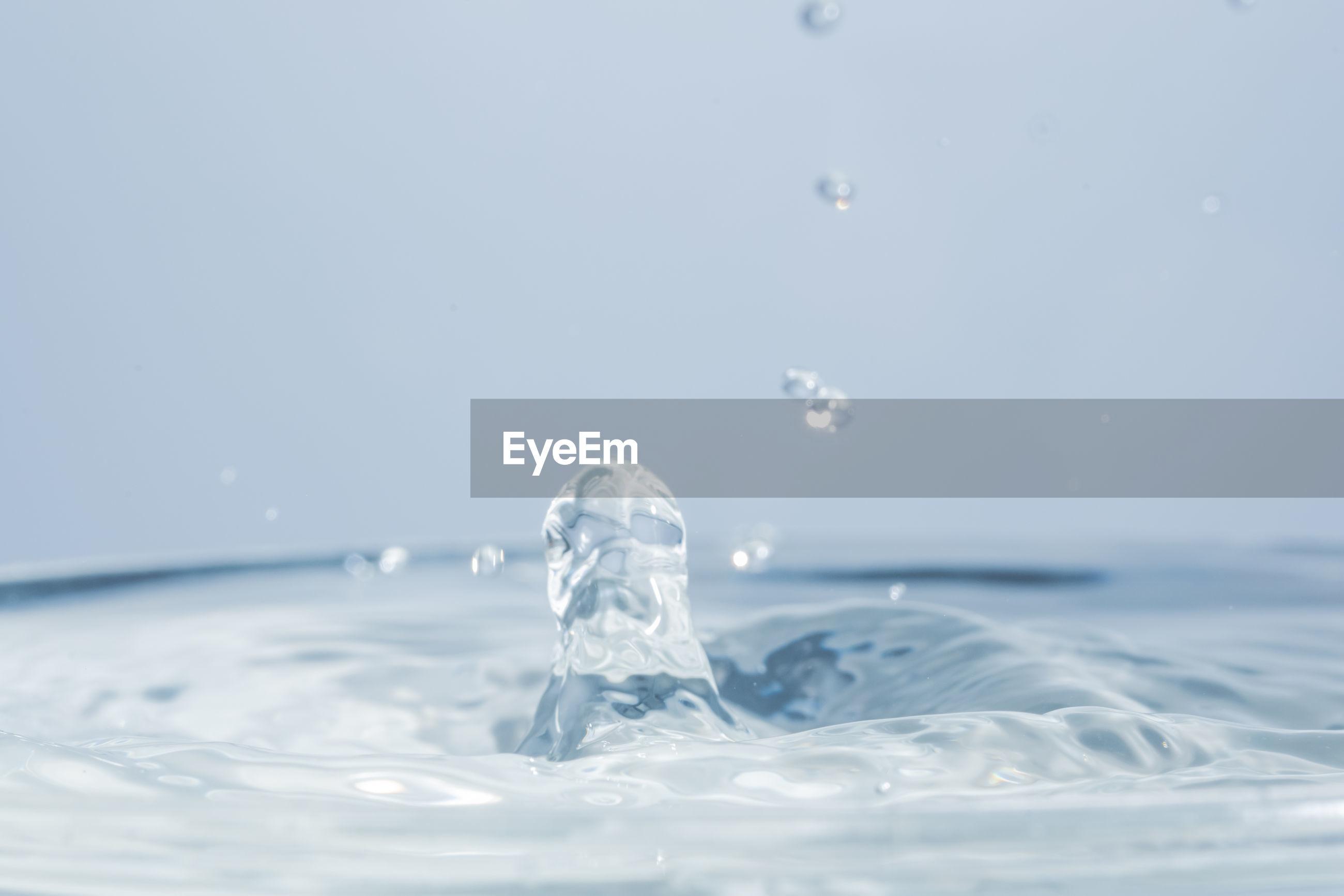 Close-up of splashing water against white background
