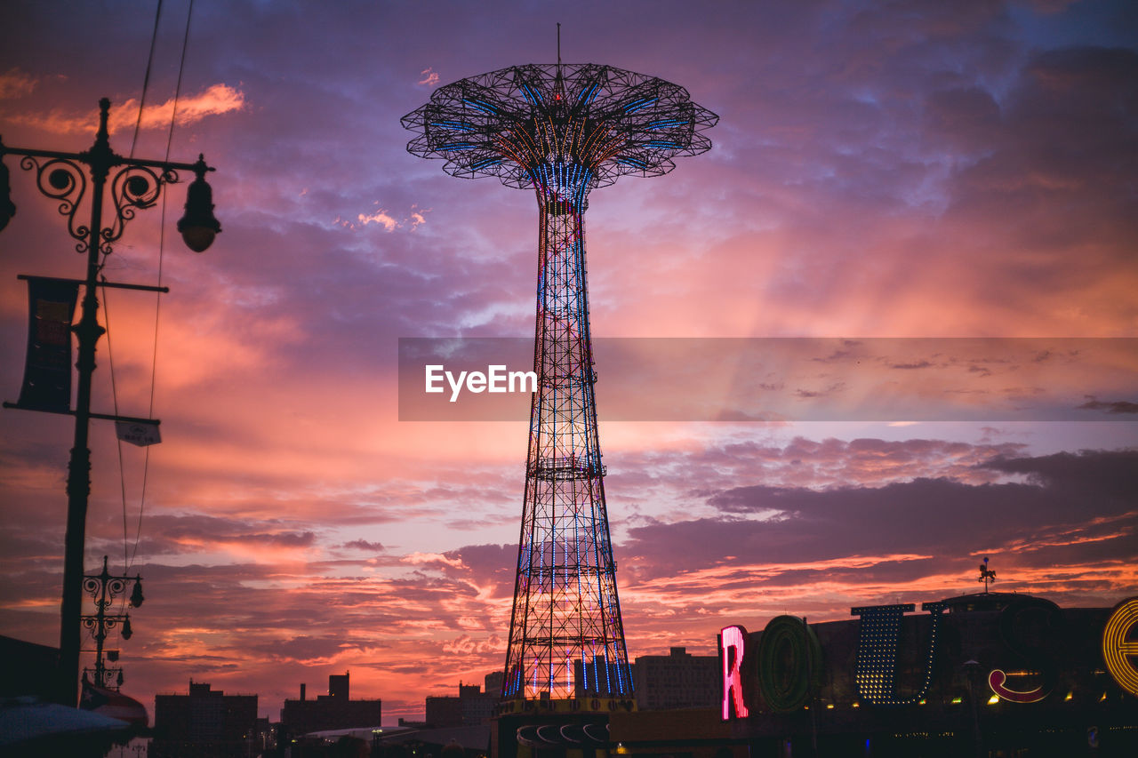 LOW ANGLE VIEW OF FERRIS WHEEL DURING SUNSET