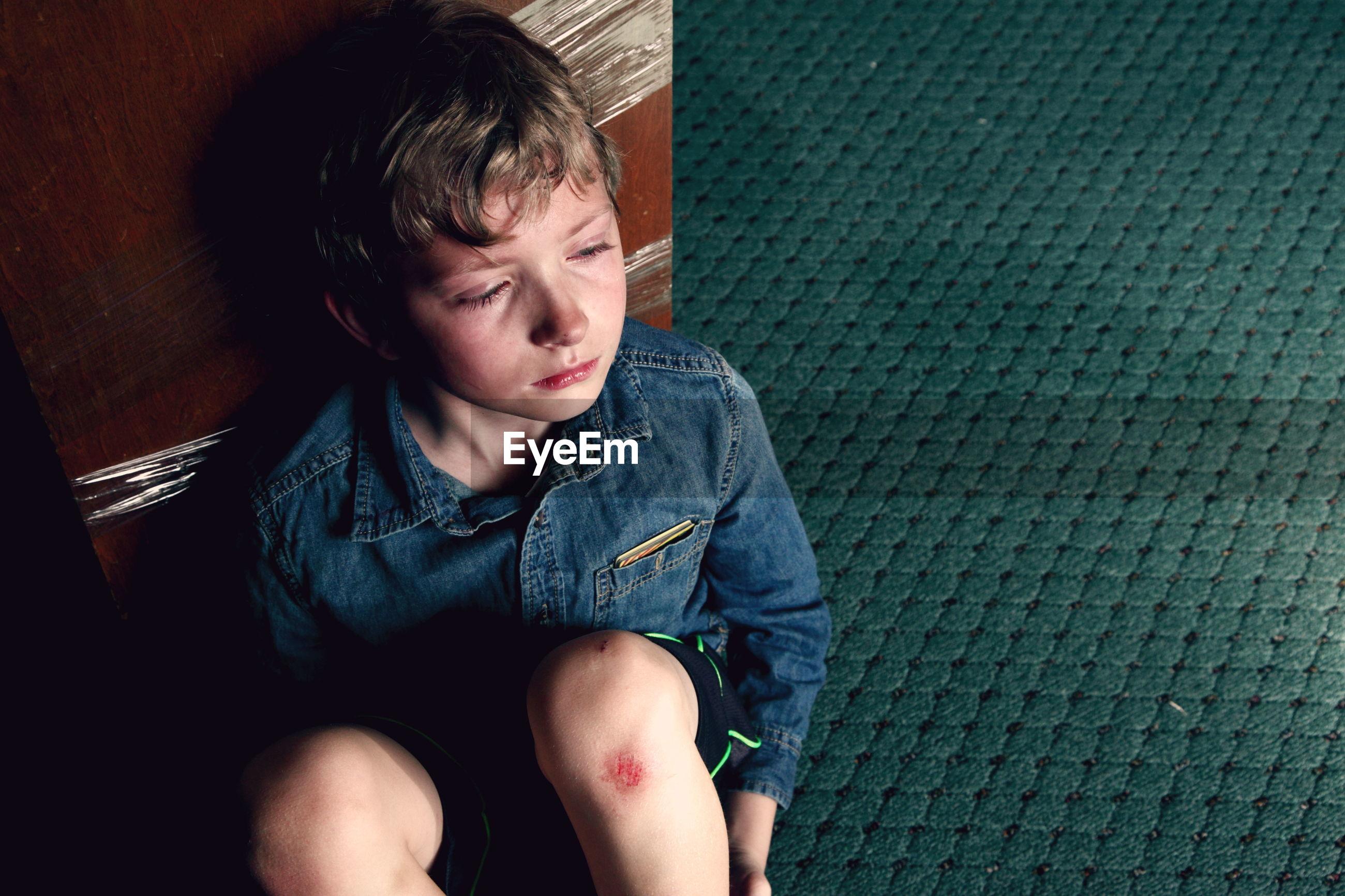 High angle view of crying boy