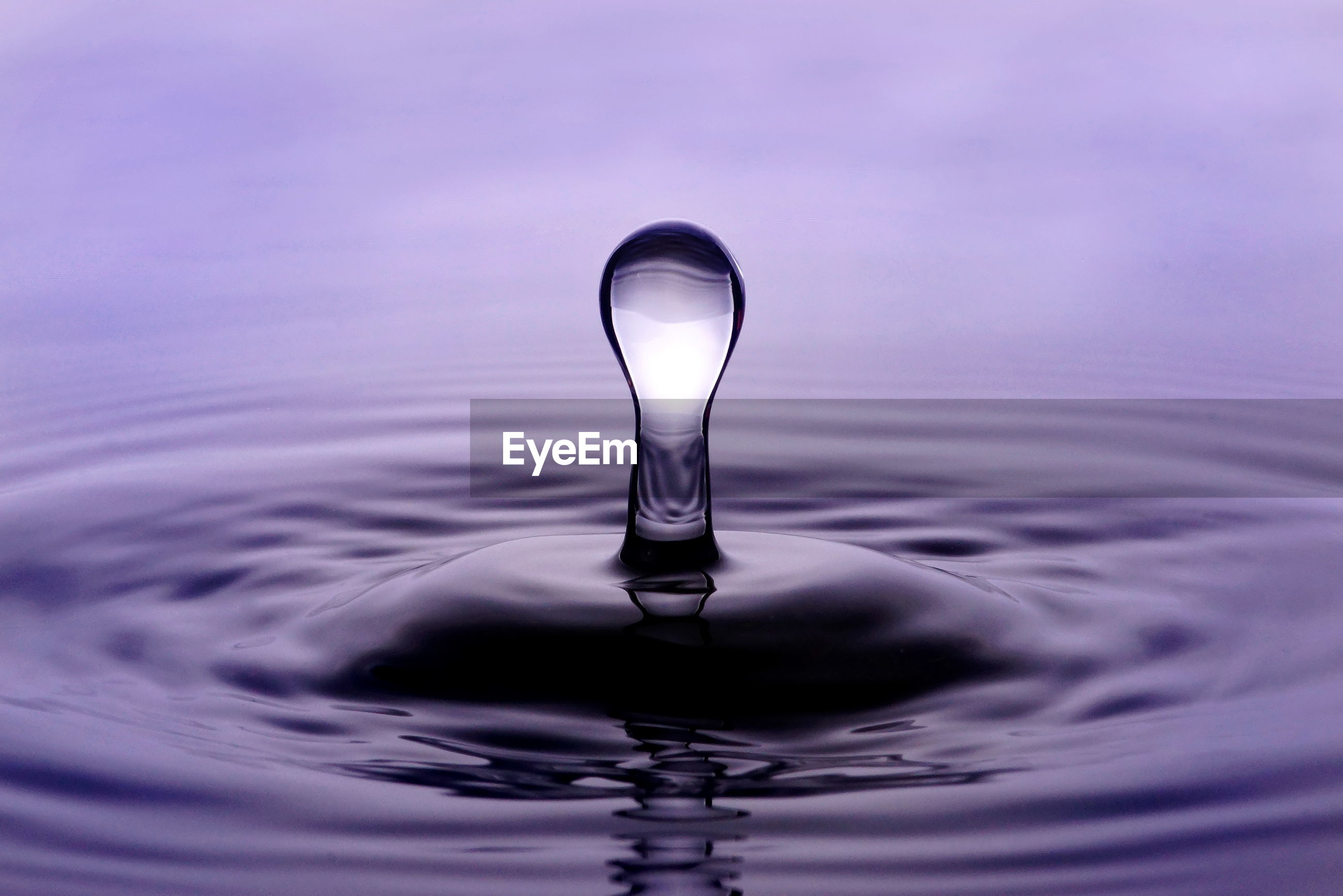 CLOSE-UP OF WATER DROP ON RIPPLED