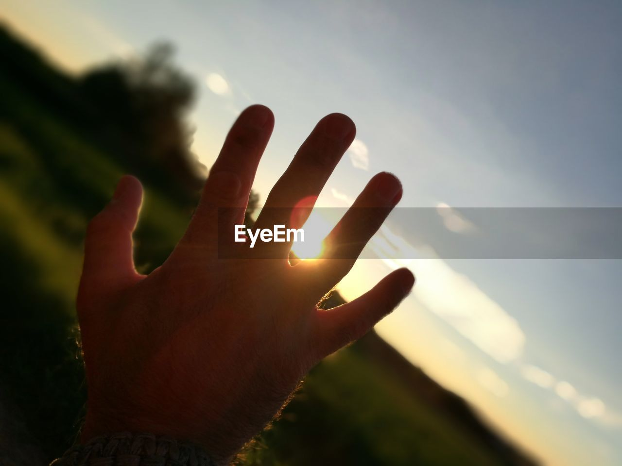 human hand, human body part, sky, human finger, focus on foreground, cloud - sky, one person, real people, outdoors, nature, close-up, day, beauty in nature, people