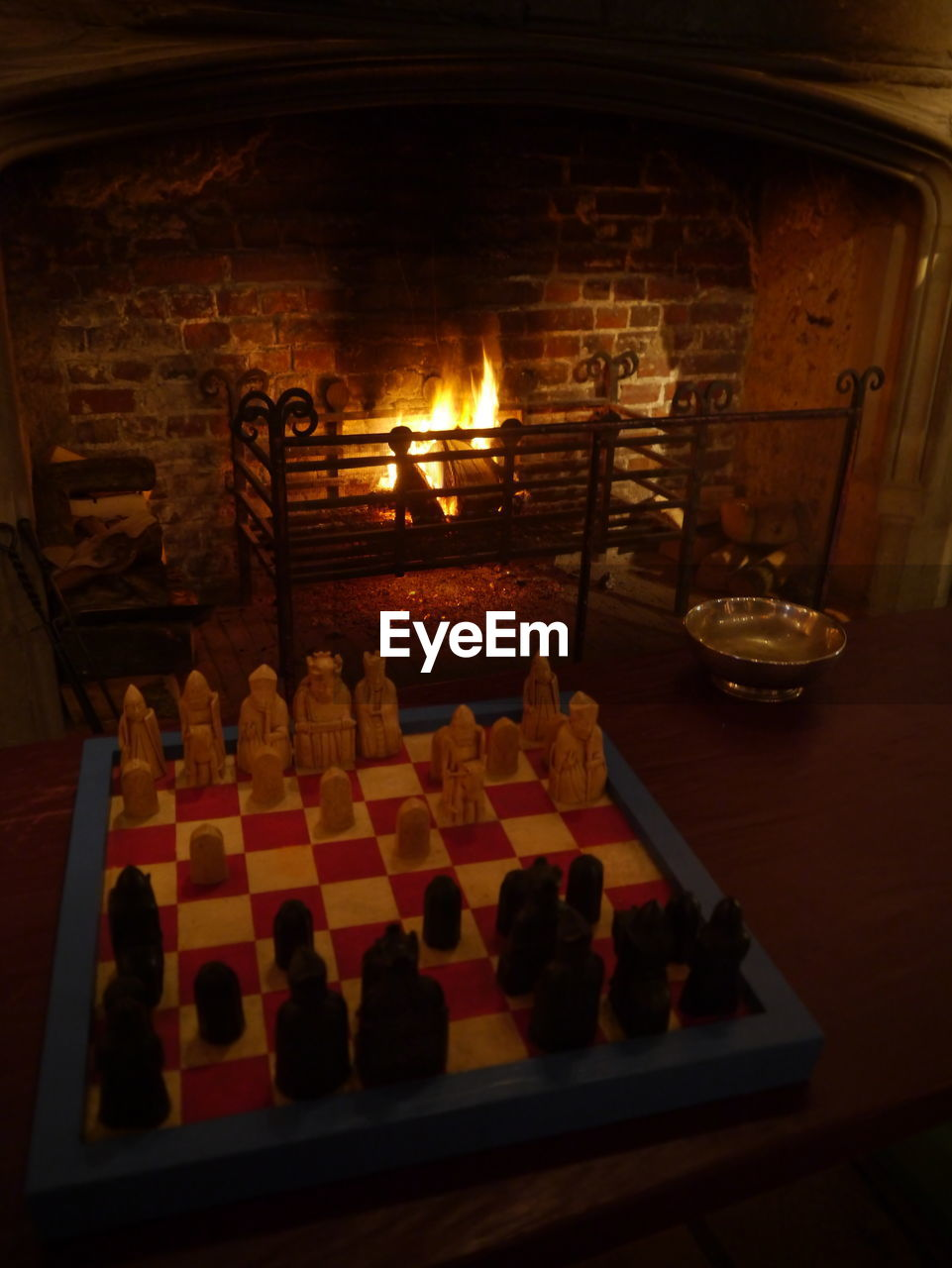 chess, indoors, chess piece, chess board, table, arrangement, no people, large group of objects, close-up, day