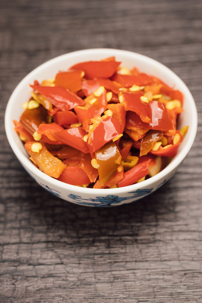 food and drink, food, table, healthy eating, freshness, still life, wellbeing, bowl, vegetable, indoors, wood - material, fruit, no people, close-up, high angle view, ready-to-eat, tomato, serving size, red, orange color, chopped, vegetarian food, fruit salad