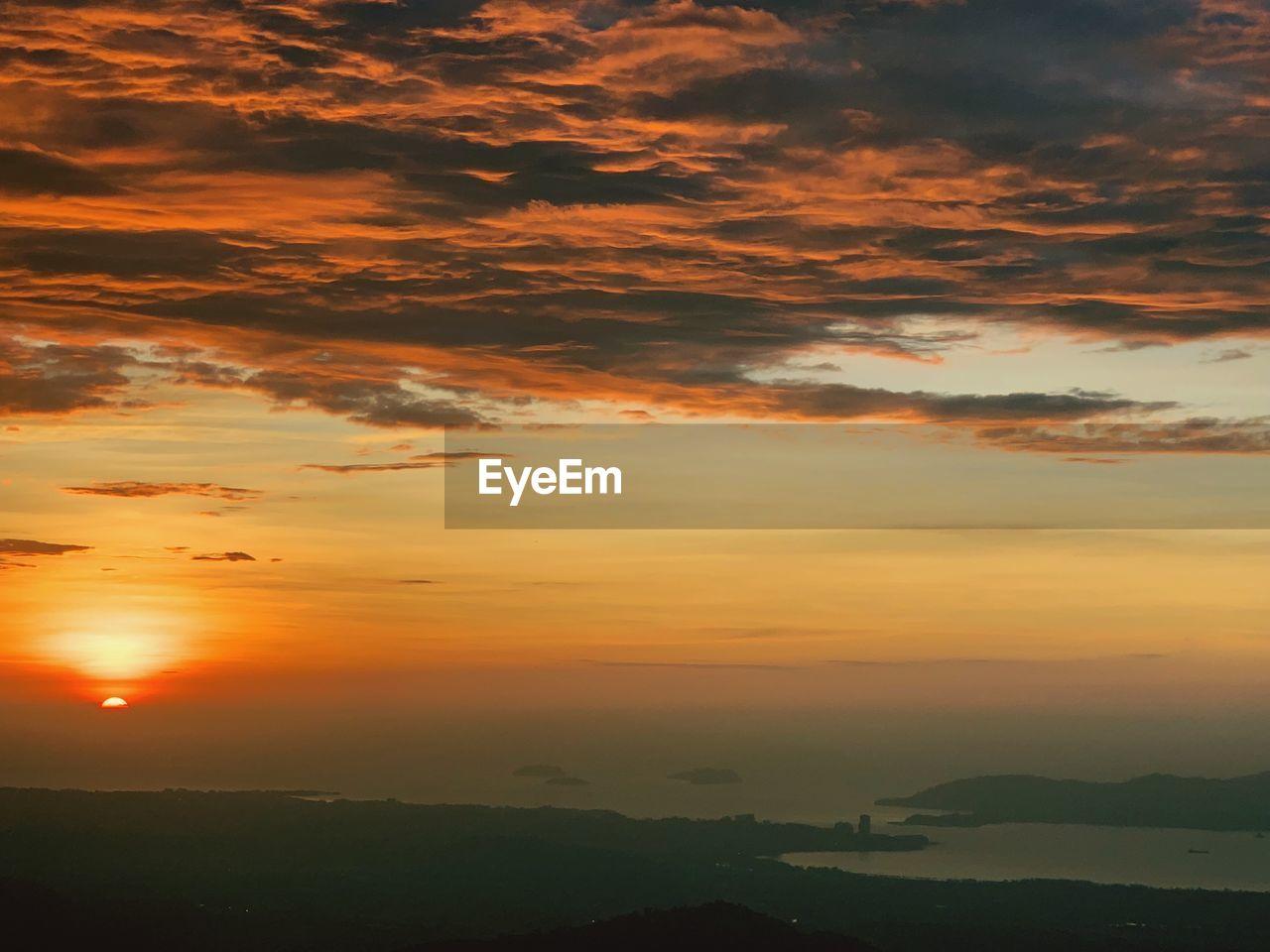 sunset, sky, beauty in nature, scenics - nature, cloud - sky, orange color, tranquil scene, tranquility, idyllic, environment, nature, no people, landscape, silhouette, non-urban scene, sun, dramatic sky, outdoors, sunlight, atmospheric mood, romantic sky