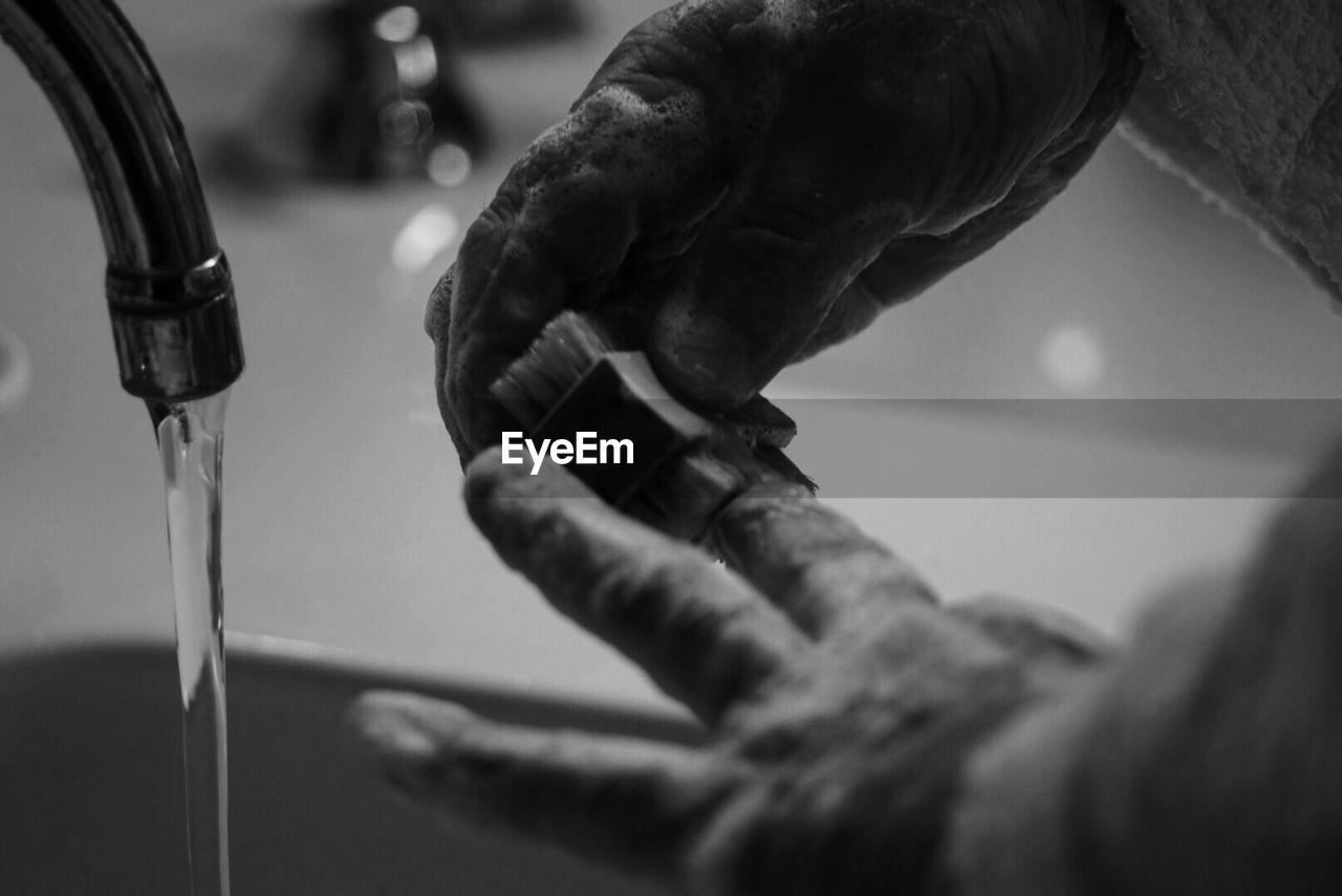 Cropped Image Of Man Washing Hands