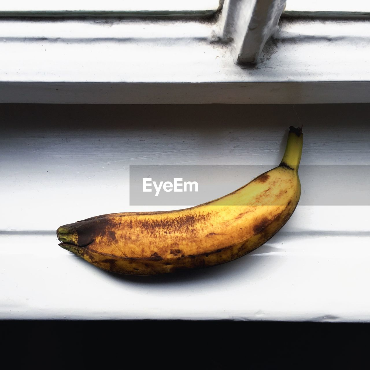 Close-Up Of Banana On Window Sill