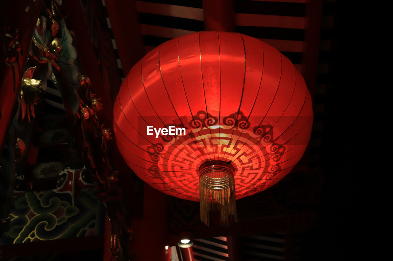 lighting equipment, lantern, chinese lantern, illuminated, decoration, red, hanging, low angle view, no people, indoors, celebration, night, communication, text, script, non-western script, event, paper lantern, chinese lantern festival, festival, ceiling, chinese new year