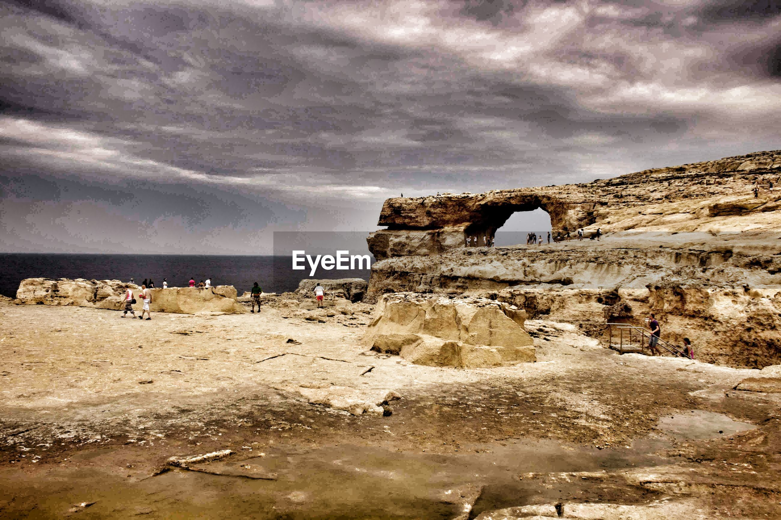sky, sea, cloud - sky, horizon over water, beach, cloudy, water, shore, scenics, rock - object, cloud, nature, beauty in nature, tranquility, built structure, tranquil scene, rock formation, sand, overcast, architecture