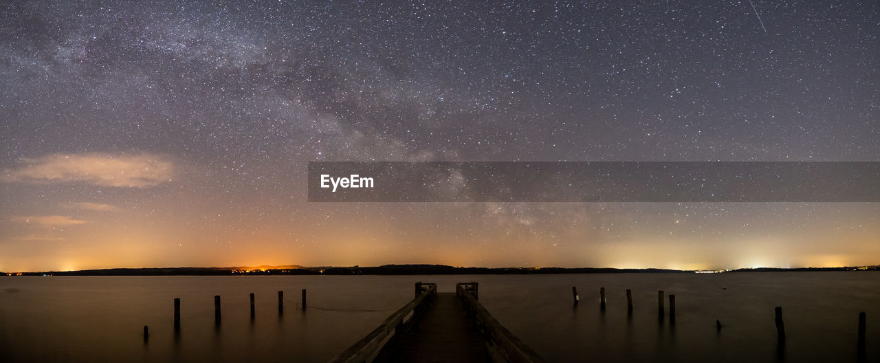 Scenic view of lake against star field at night