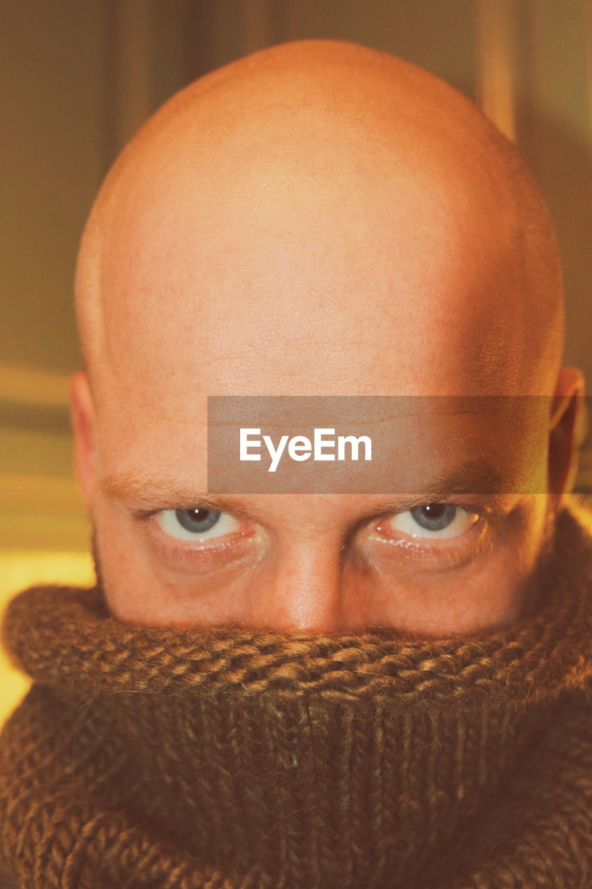 Close-Up Portrait Of Bald Mid Adult Man Wearing Turtleneck