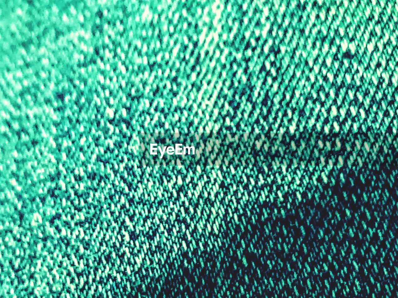 full frame, backgrounds, textile, green color, close-up, no people, pattern, textured, indoors, wool, selective focus, industry, large group of objects, abstract, technology, copy space, clothing, garment, blue, defocused, softness