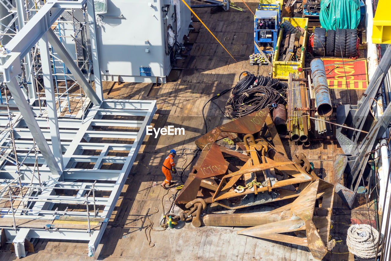 HIGH ANGLE VIEW OF CONSTRUCTION SITE AT COMMERCIAL DOCK