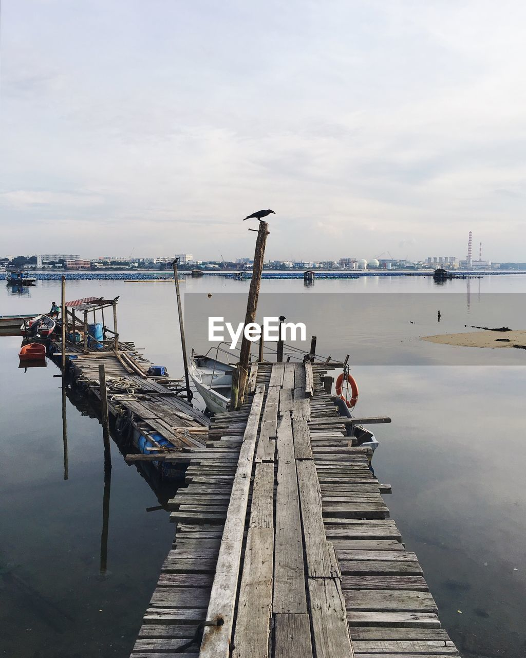 pier, water, jetty, sky, cloud - sky, nautical vessel, wood - material, moored, outdoors, nature, day, transportation, built structure, harbor, sea, no people, commercial dock, beauty in nature