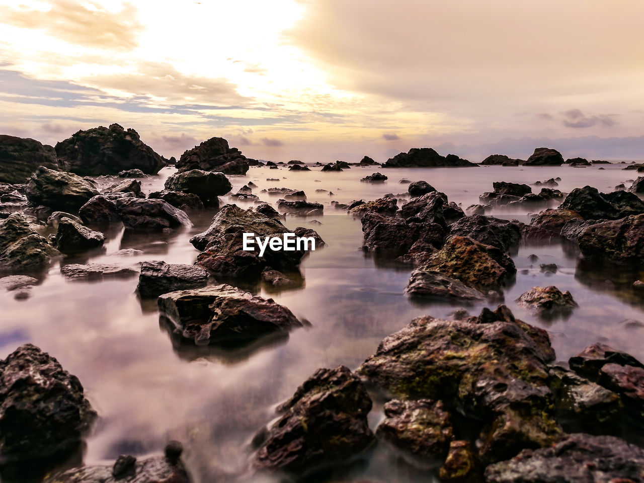 nature, beauty in nature, water, sky, scenics, sunset, rock - object, no people, tranquility, idyllic, tranquil scene, outdoors, cloud - sky, sea, long exposure, motion, day