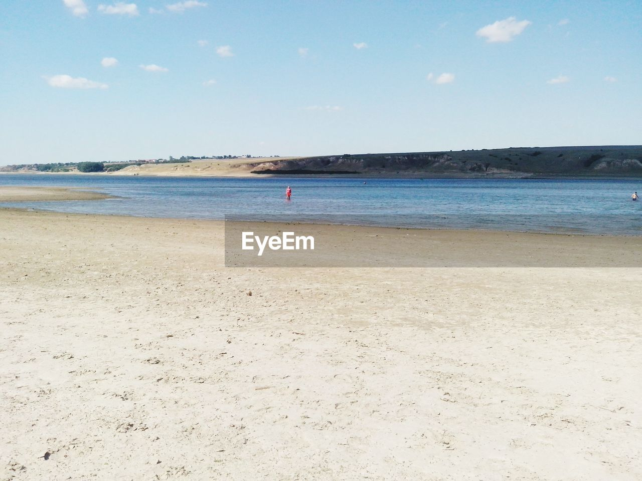 sea, beach, land, water, sky, scenics - nature, beauty in nature, sand, horizon, tranquility, tranquil scene, horizon over water, day, nature, non-urban scene, incidental people, outdoors, holiday, cloud - sky