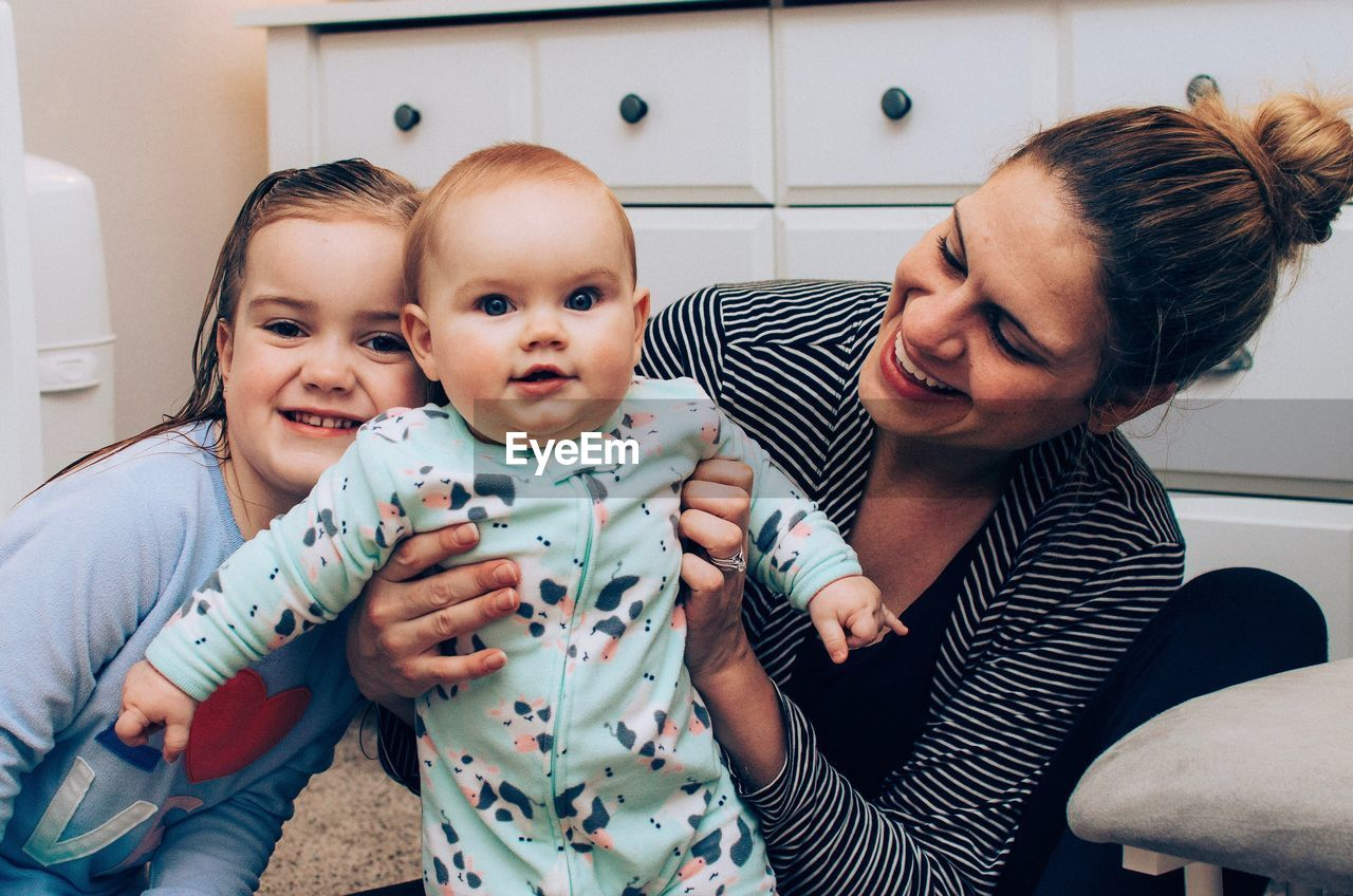 Happy Mother With Kids At Home