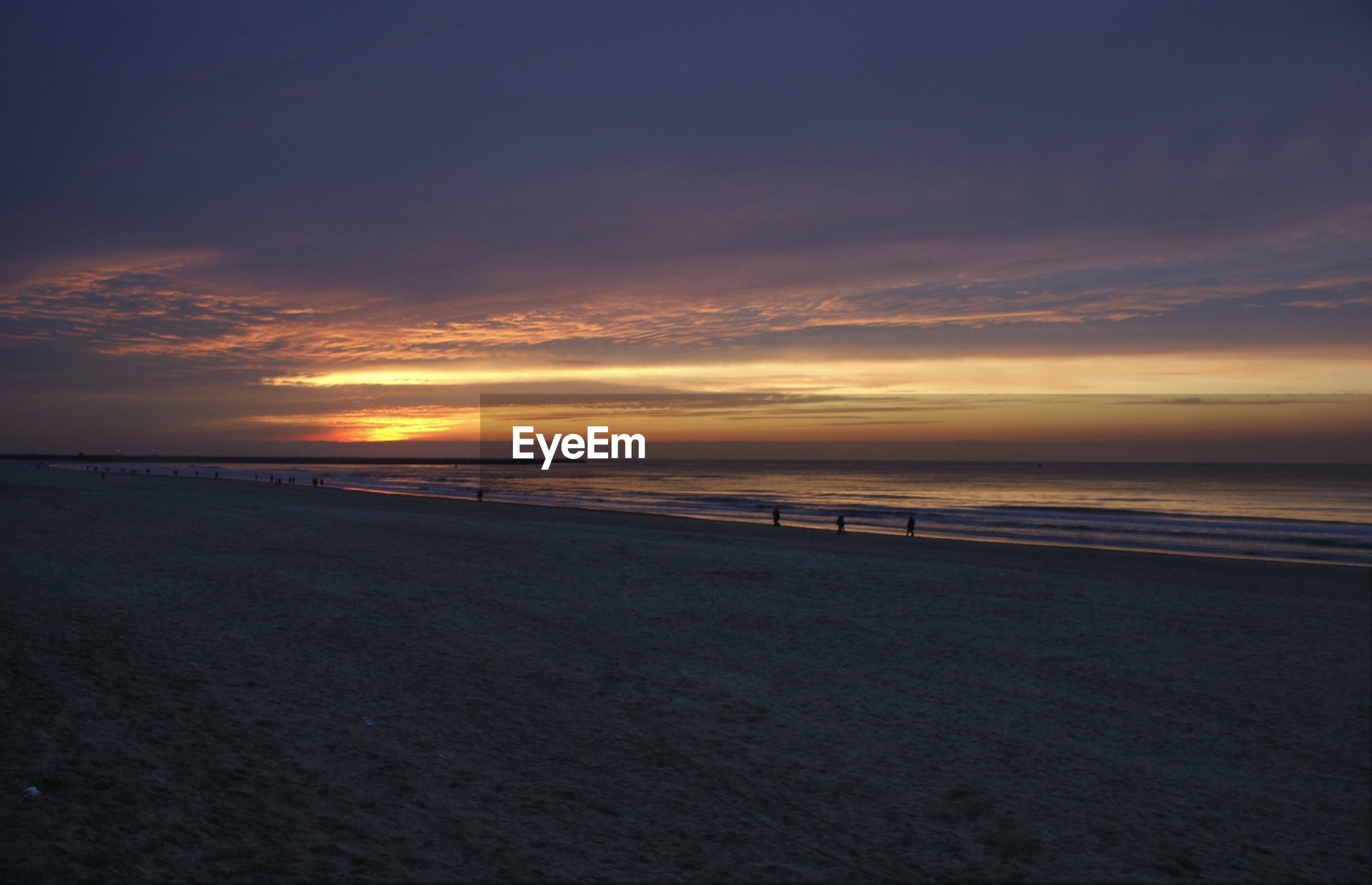 sea, sunset, horizon over water, beach, water, scenics, tranquil scene, sky, shore, tranquility, beauty in nature, sand, orange color, idyllic, nature, silhouette, cloud - sky, incidental people, cloud, coastline